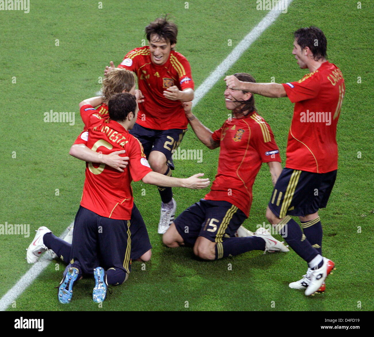 Spanish Goalgetter Fernando Torres (L) is celebrated by teammates after scoring the 1-0 for his team during the - Stock Image
