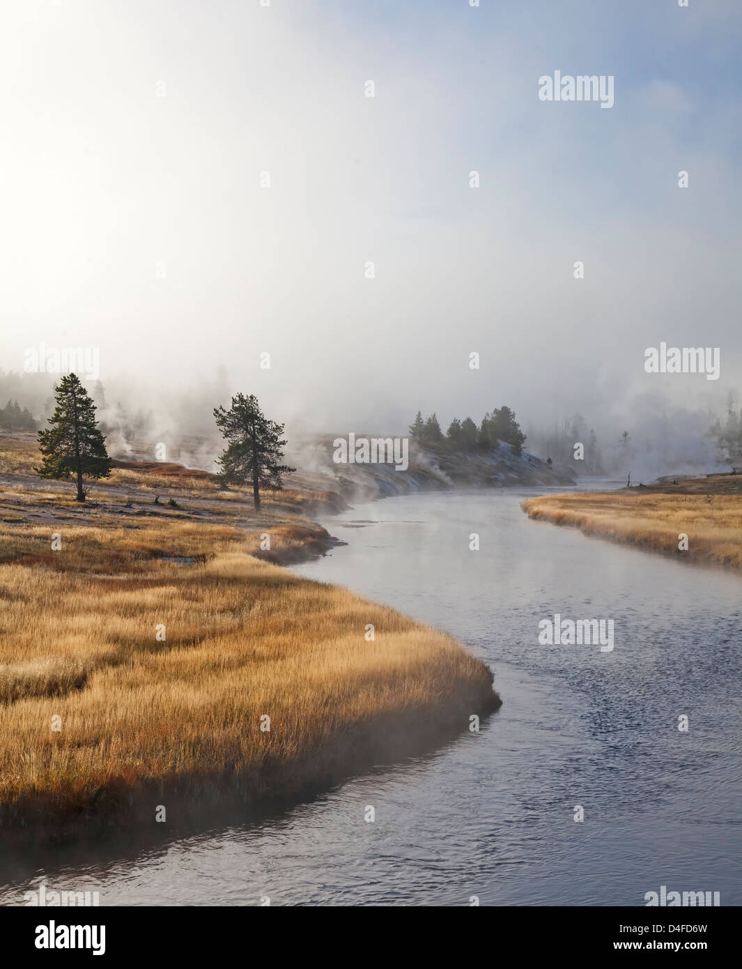 River winding through rural landscape - Stock Image