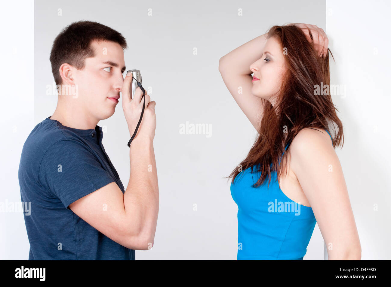 young man taking pictures of his girlfriend Stock Photo