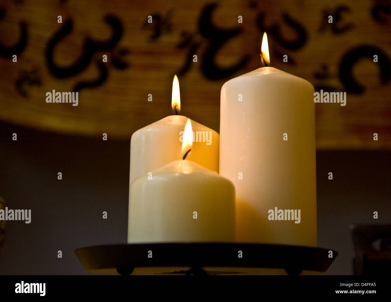 Candles on display in a yoga studio - Stock Image