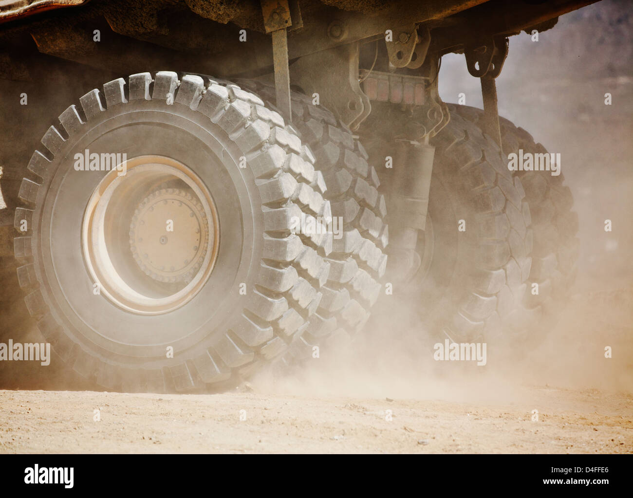 Close up of machinery wheels on site - Stock Image