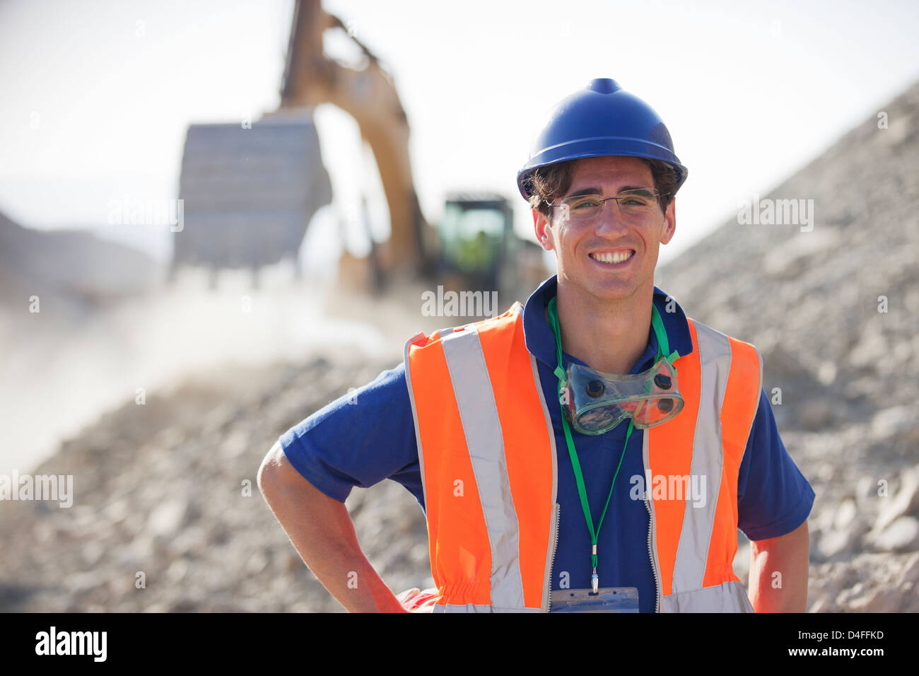 Worker smiling in quarry - Stock Image