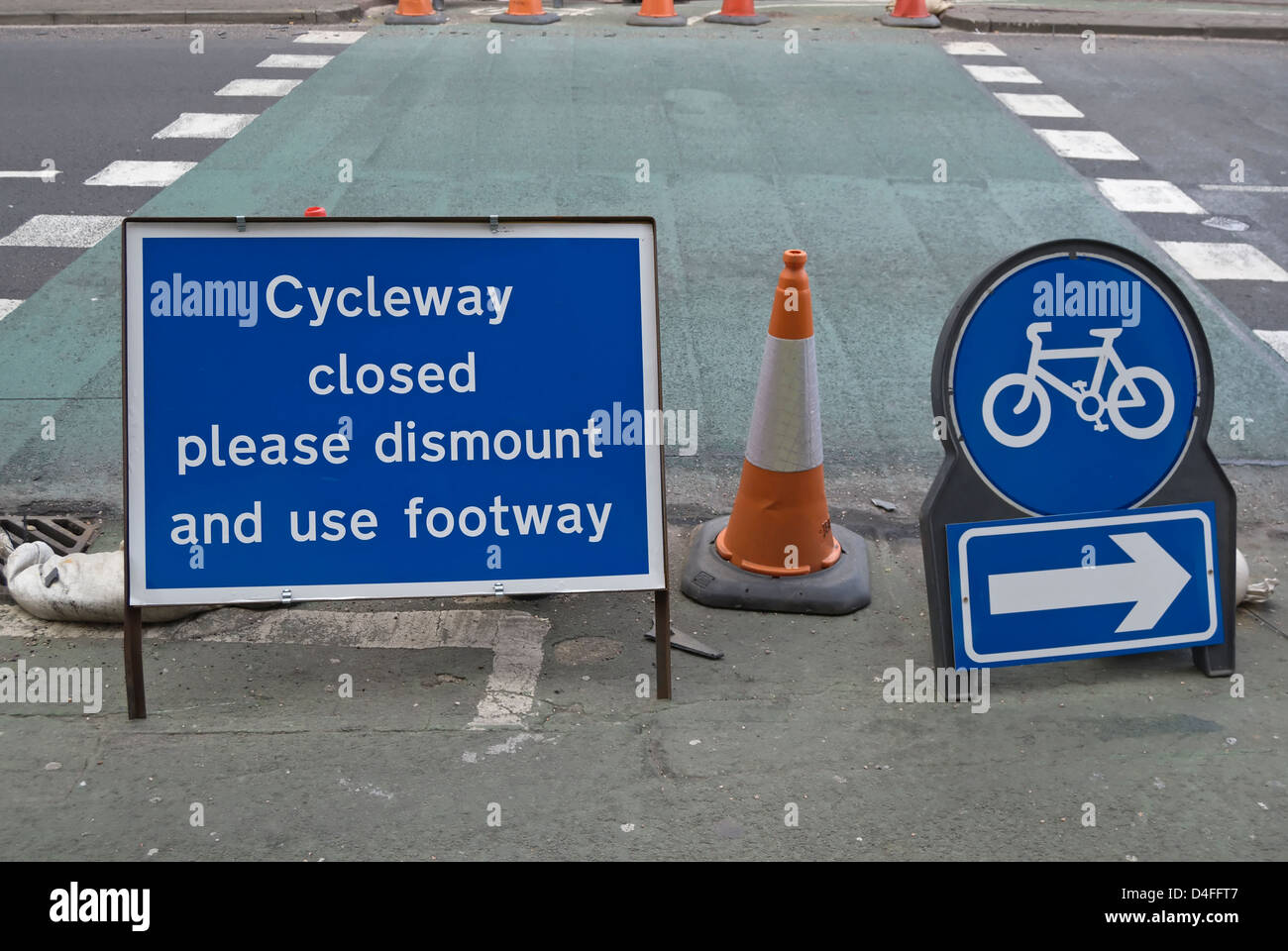 cycleway closed please dismount and use footway sign, kingston upon thames, surrey, england - Stock Image
