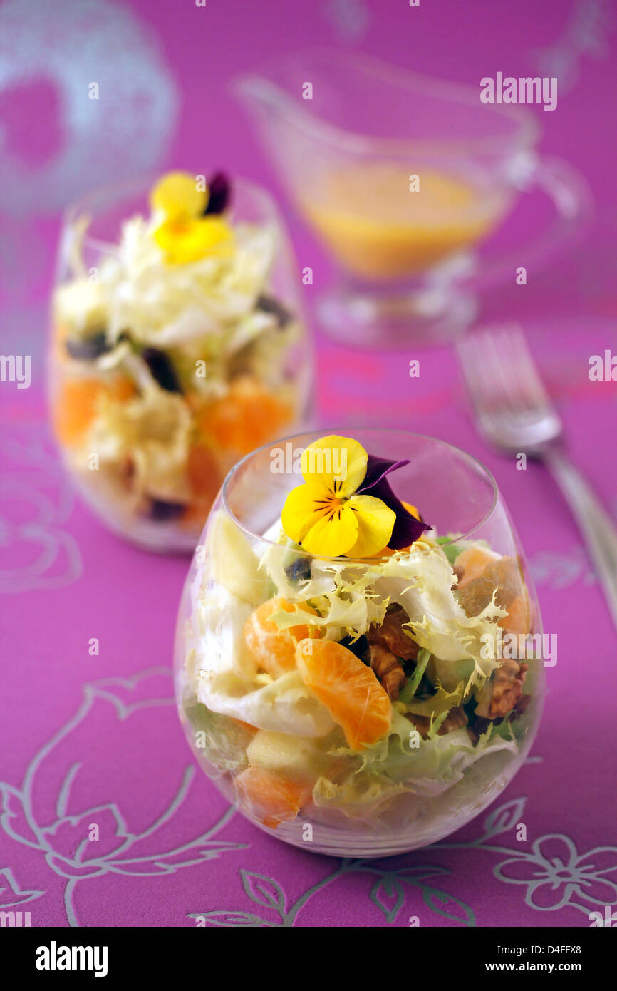 Escarole salad with tangerines. Recipe available. - Stock Image