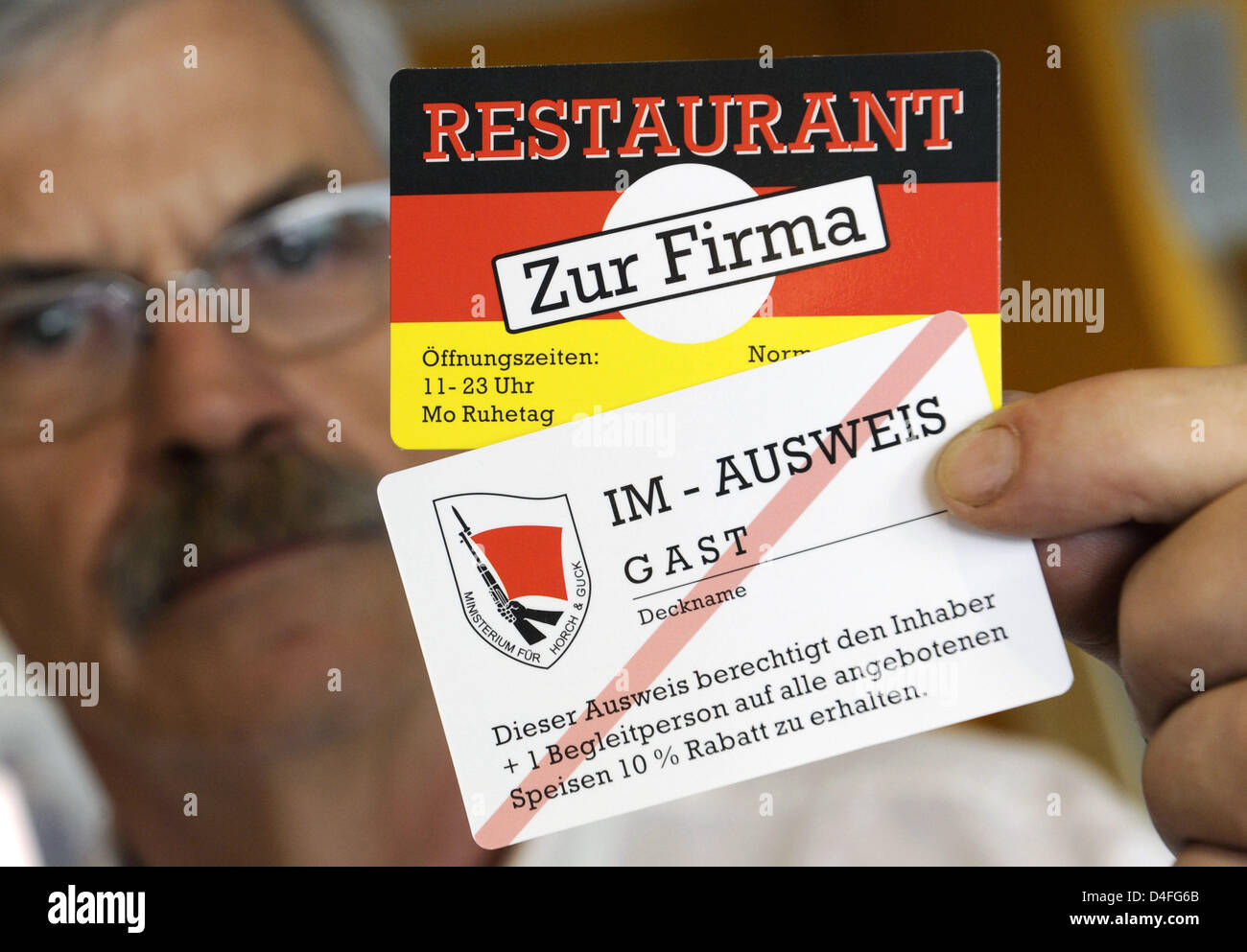 Willi Gau shows permanent guests' discount cards designed as 'IM id-cards' (IM=inofficial agent) at - Stock Image
