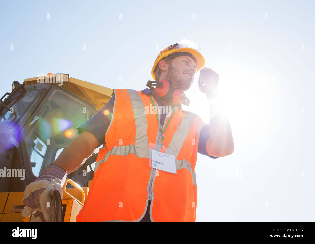 Worker using walkie-talkie on site Stock Photo