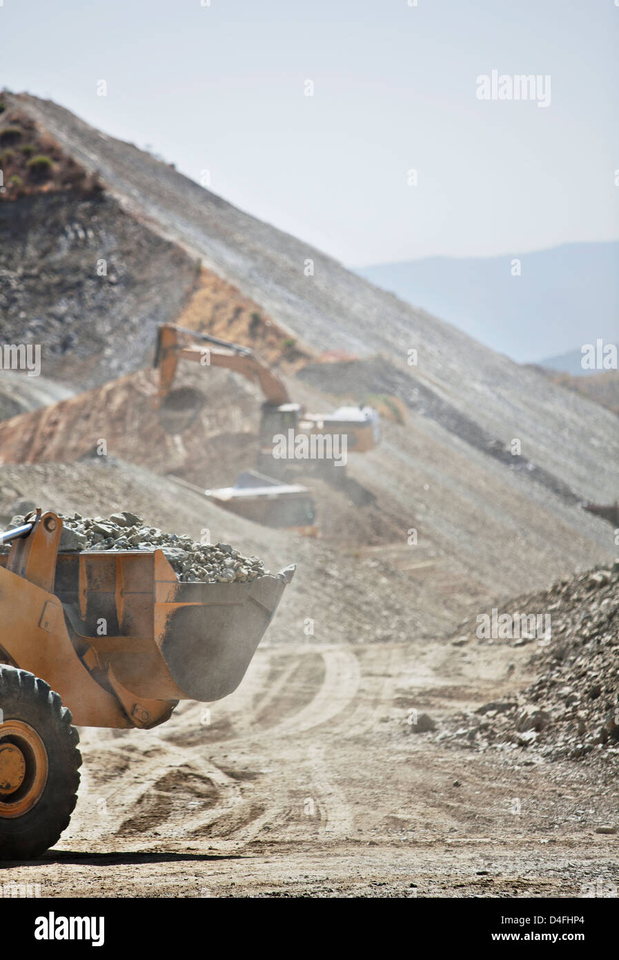 Diggers working in quarry - Stock Image