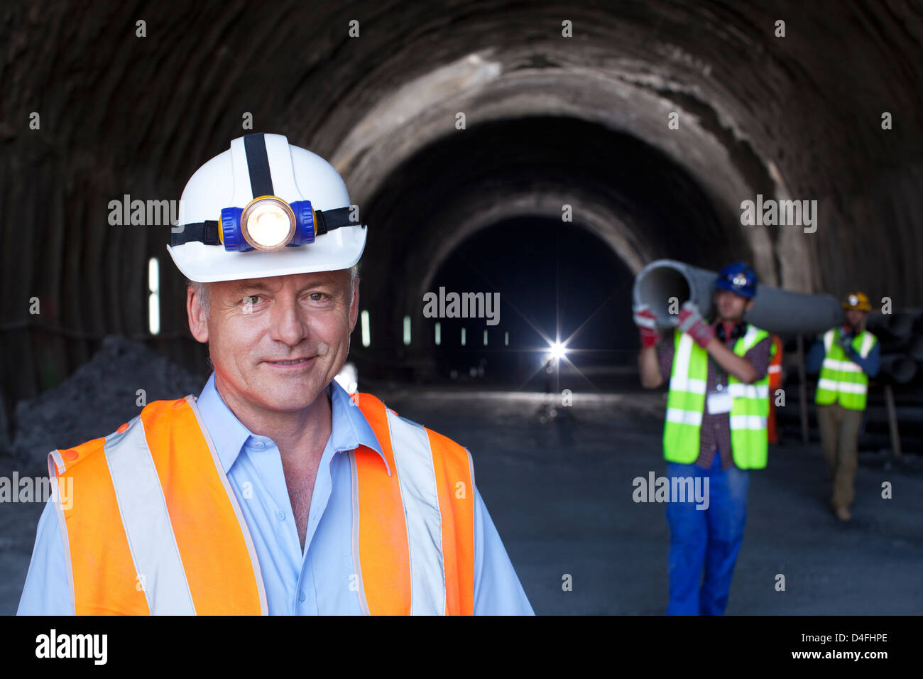 Businessman standing in tunnel Stock Photo