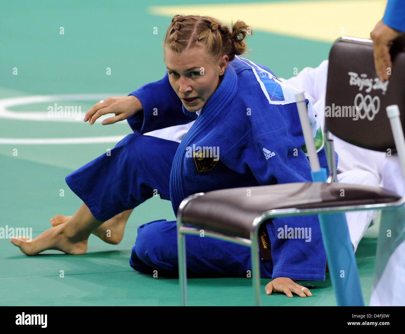 Michaela Baschin of Germany competes against Moussa (unseen) of Algeria in the first round in the 48kg category - Stock Image
