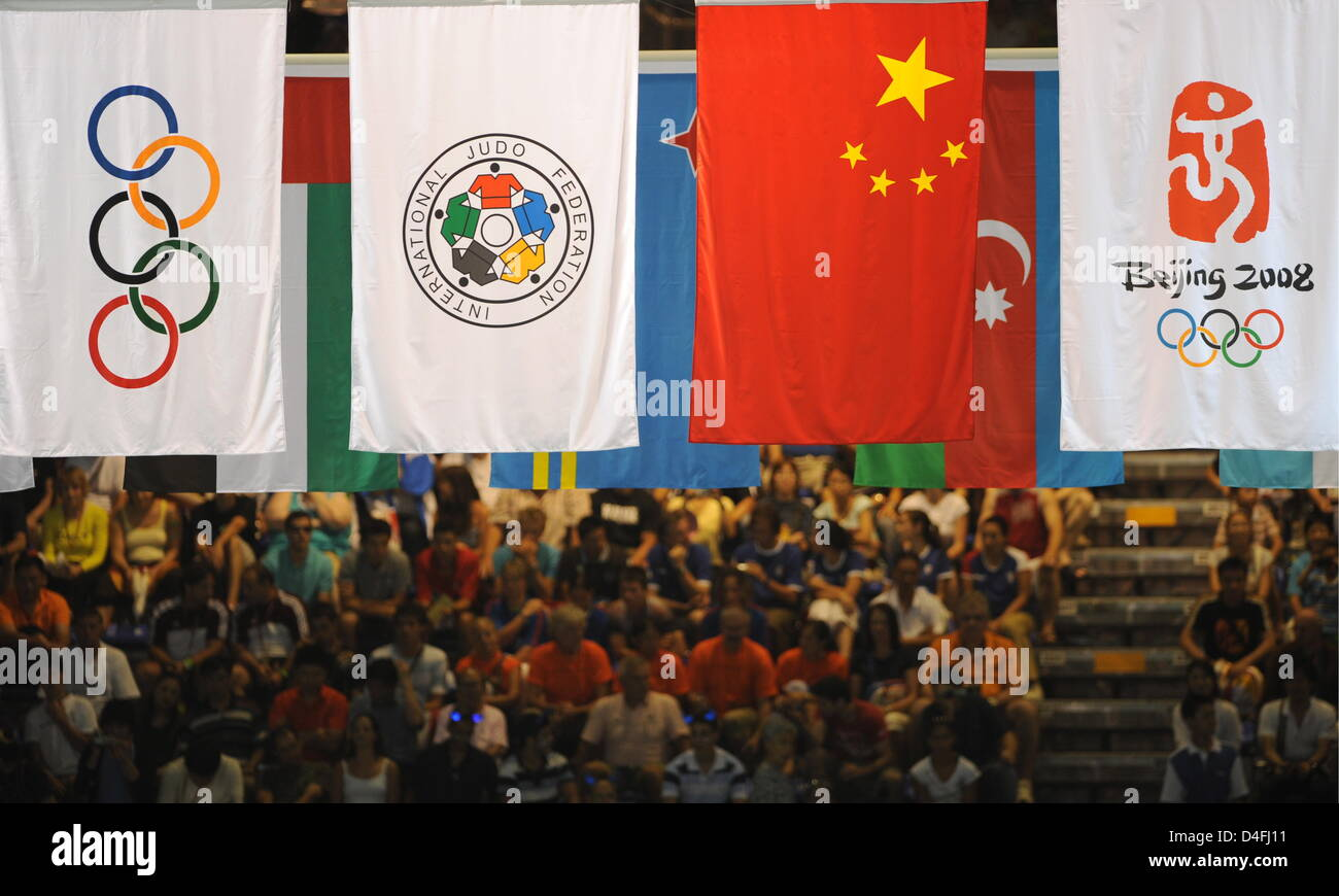 View on the spactators and olympic flags during the first round in the 48kg category of the women's judo events - Stock Image