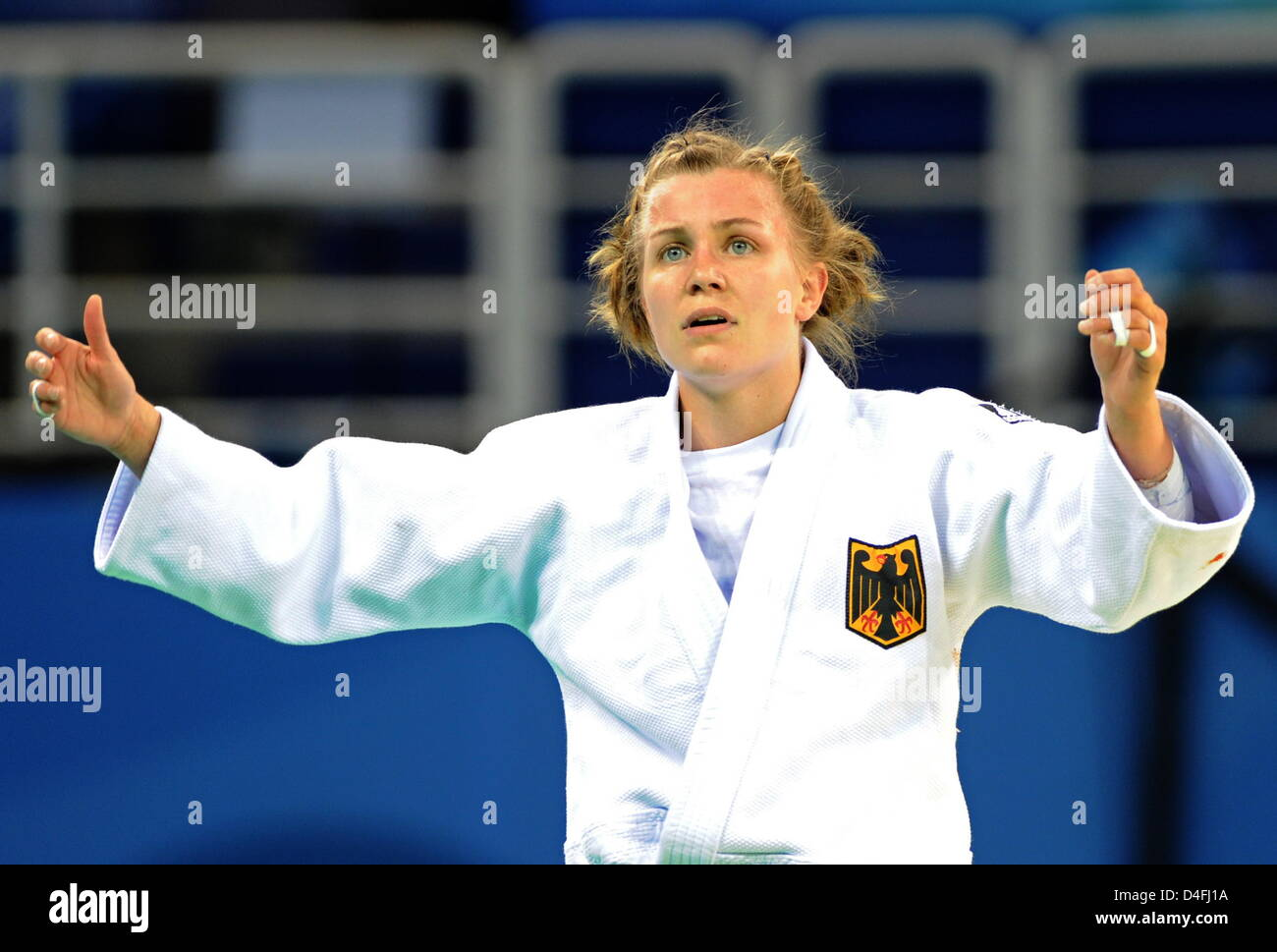 Michaela Baschin of Germany loose against Ludmilla Bogdanova of Russia in the repechage round in the 48kg category - Stock Image