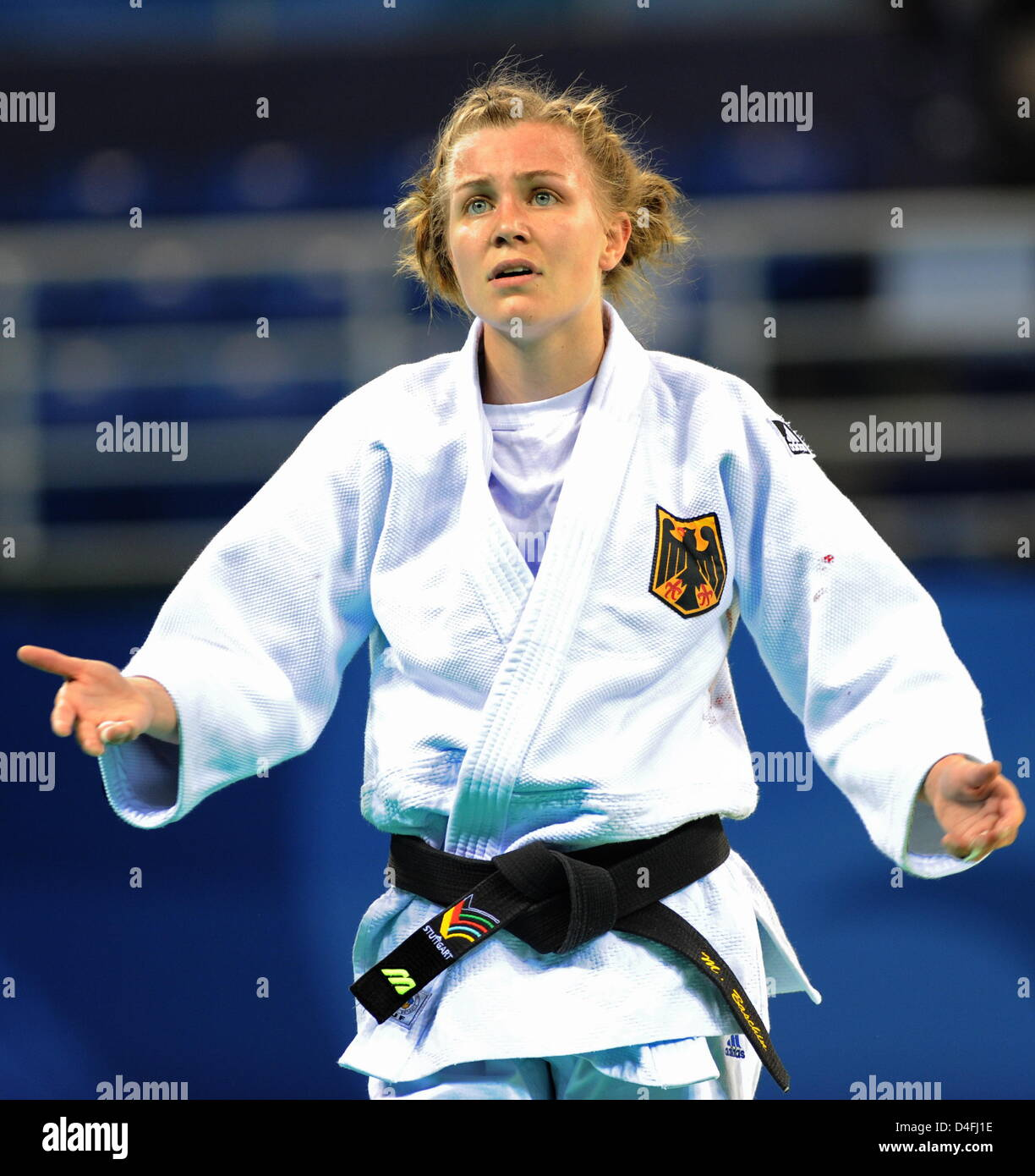 Michaela Baschin of Germany looses against Ludmilla Bogdanova (unseen) of Russia in the repechage round in the 48kg - Stock Image