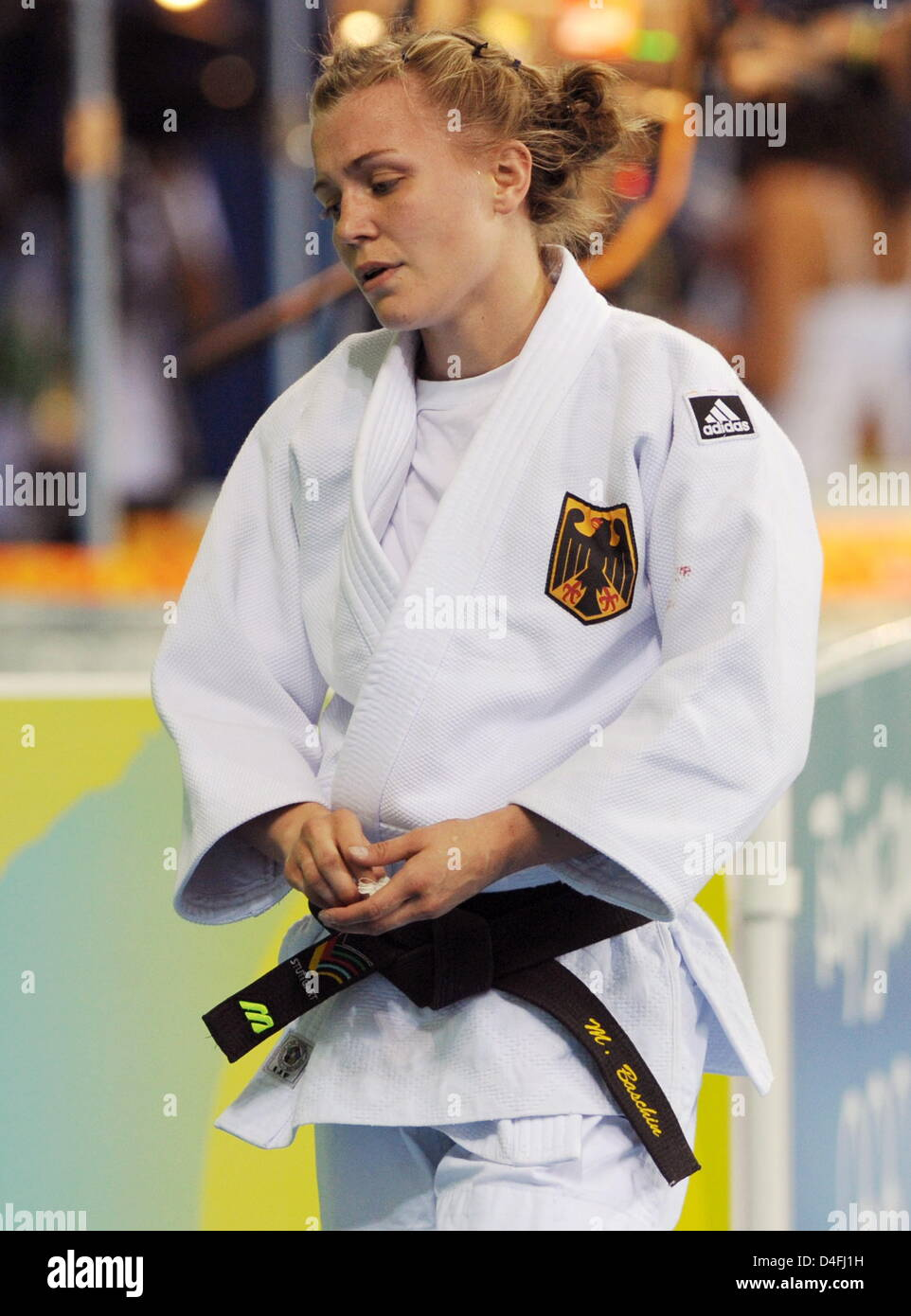 Michaela Baschin of Germany loose against Ludmilla Bogdanova (unseen) of Russia in the repechage round in the 48kg - Stock Image