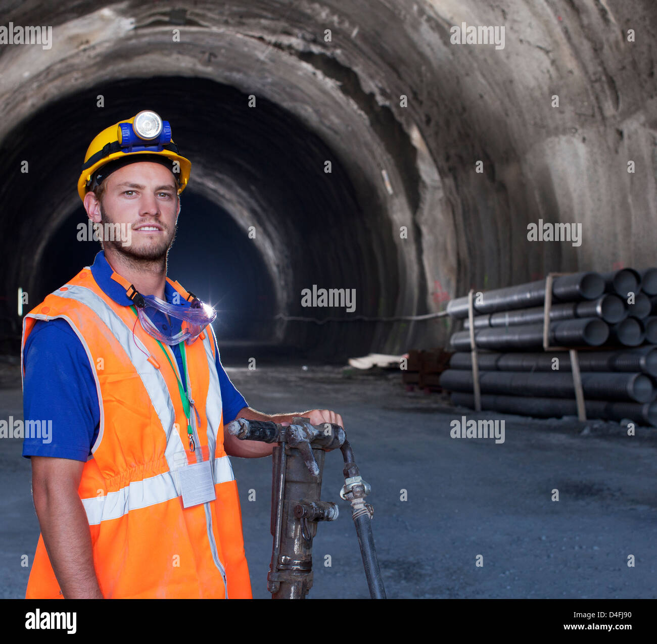 Worker standing in tunnel Stock Photo