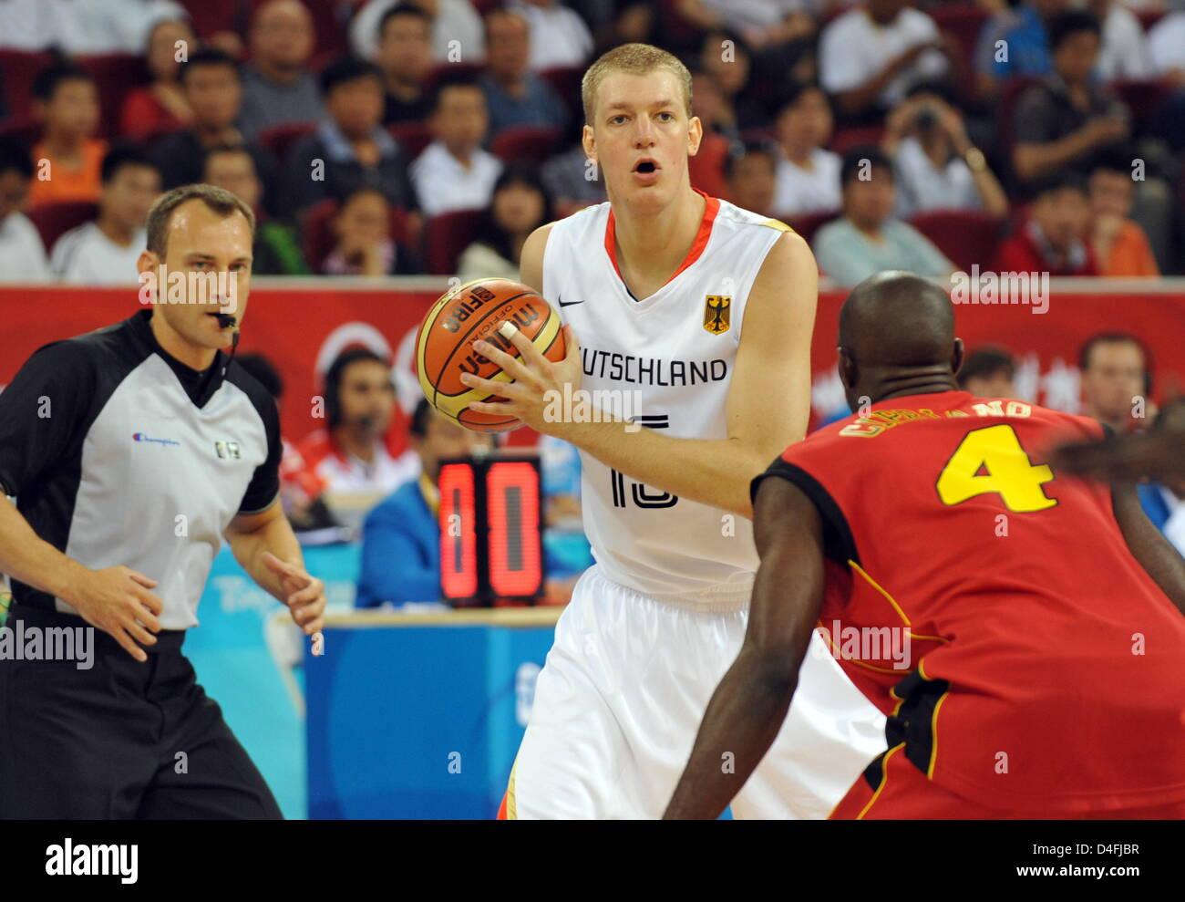 the german basketball player jan hendrik jagla c vies with olimpio