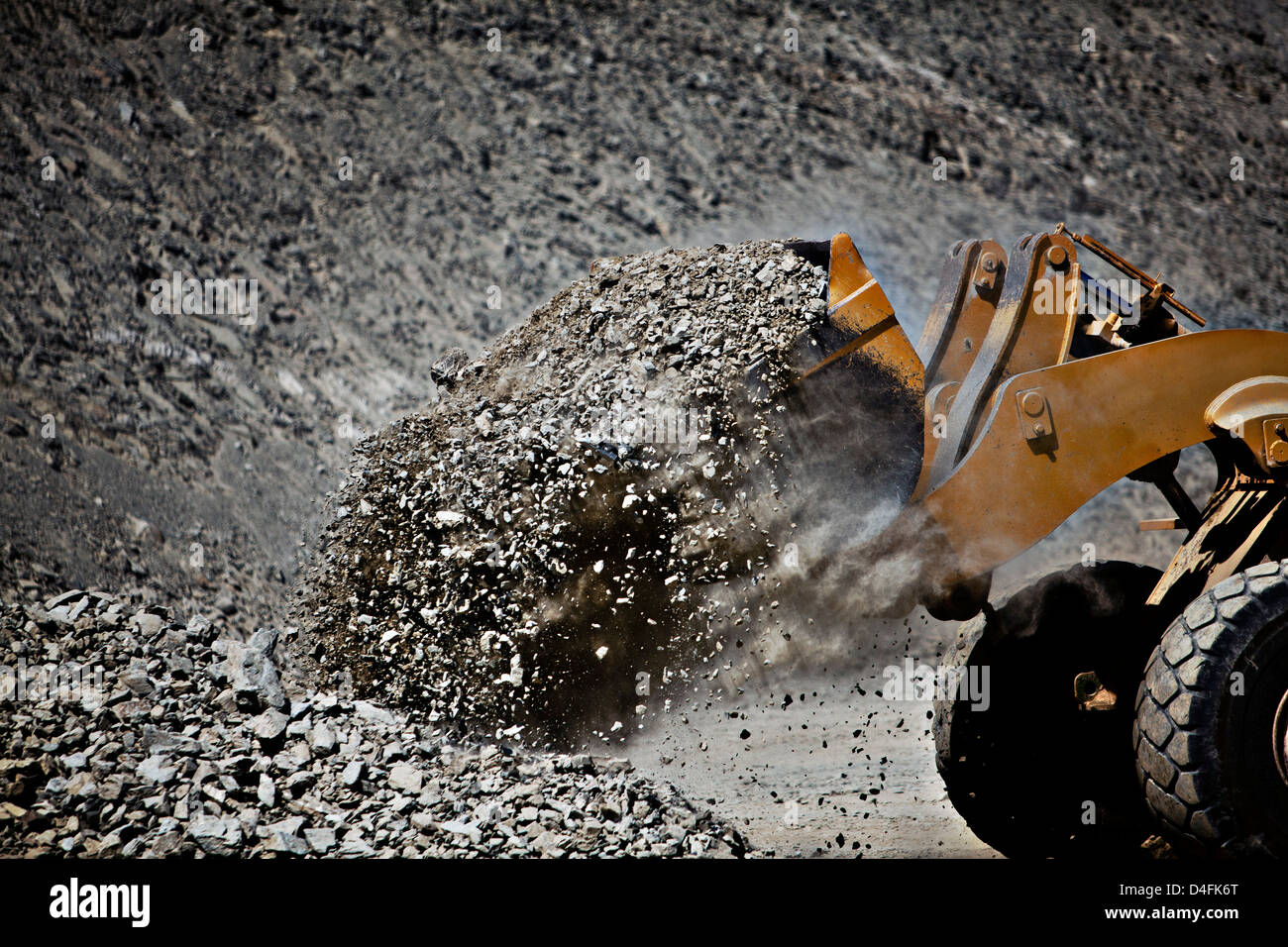 Digger working in quarry - Stock Image