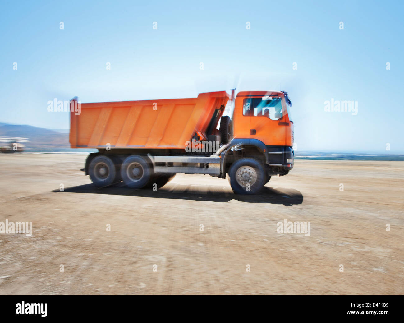 Blurred view of truck on site - Stock Image