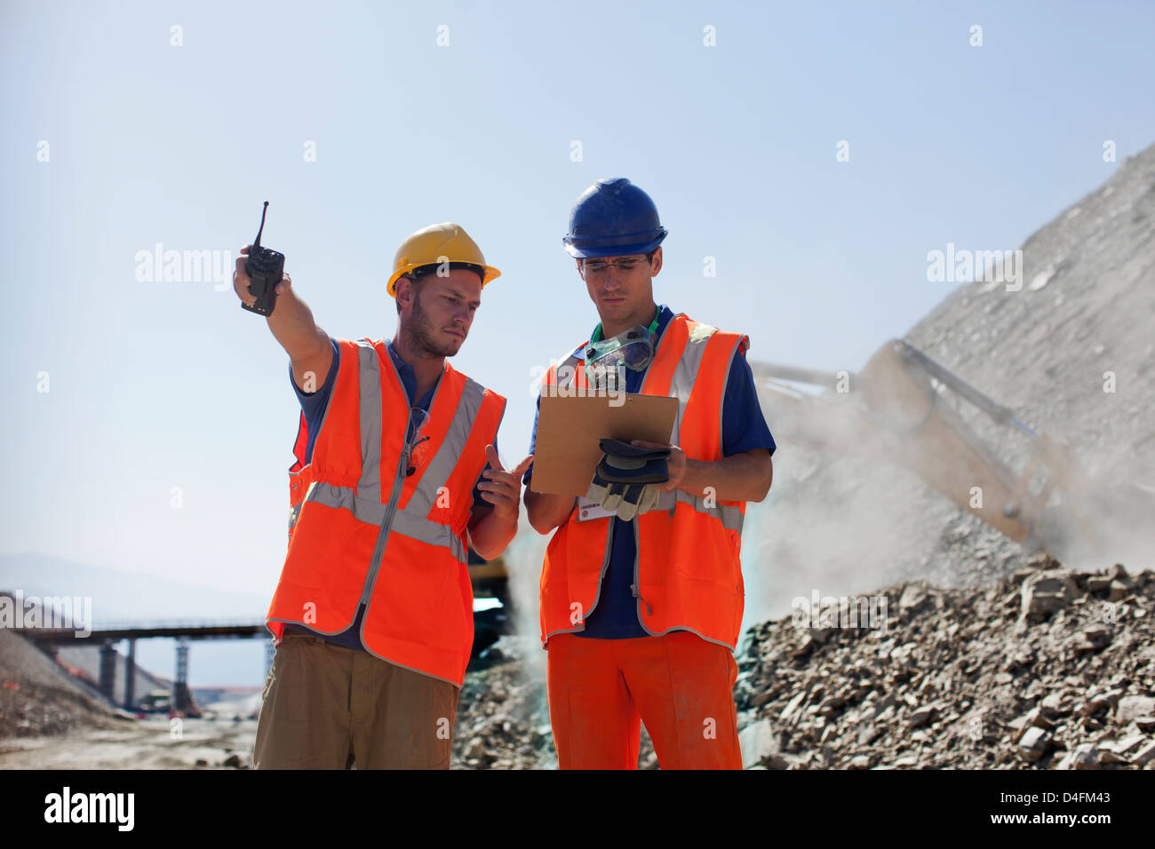 Workers talking in quarry - Stock Image
