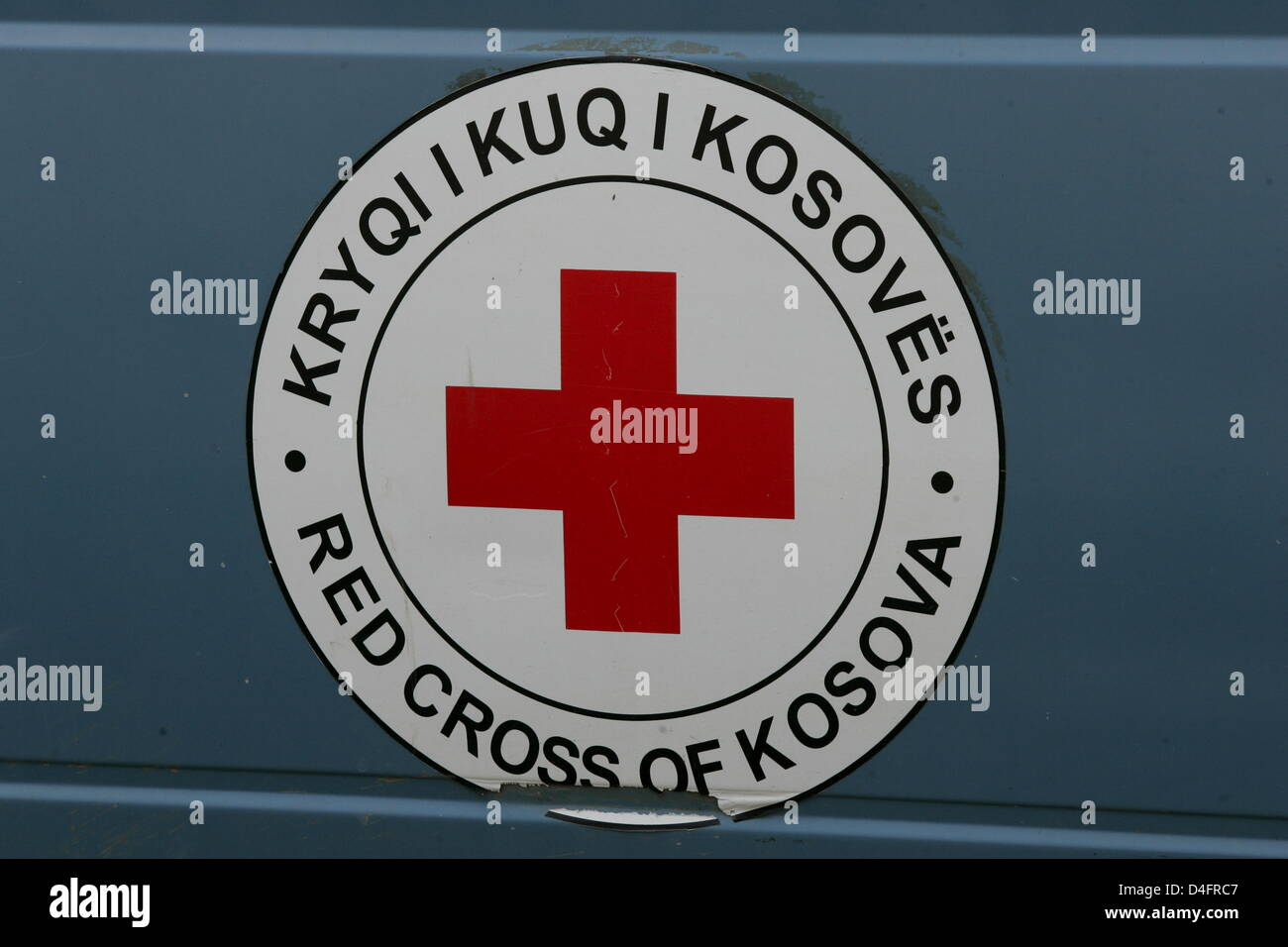 The Red Cross Symbol In The Kosovo Featuring Bilingual Letters Seen