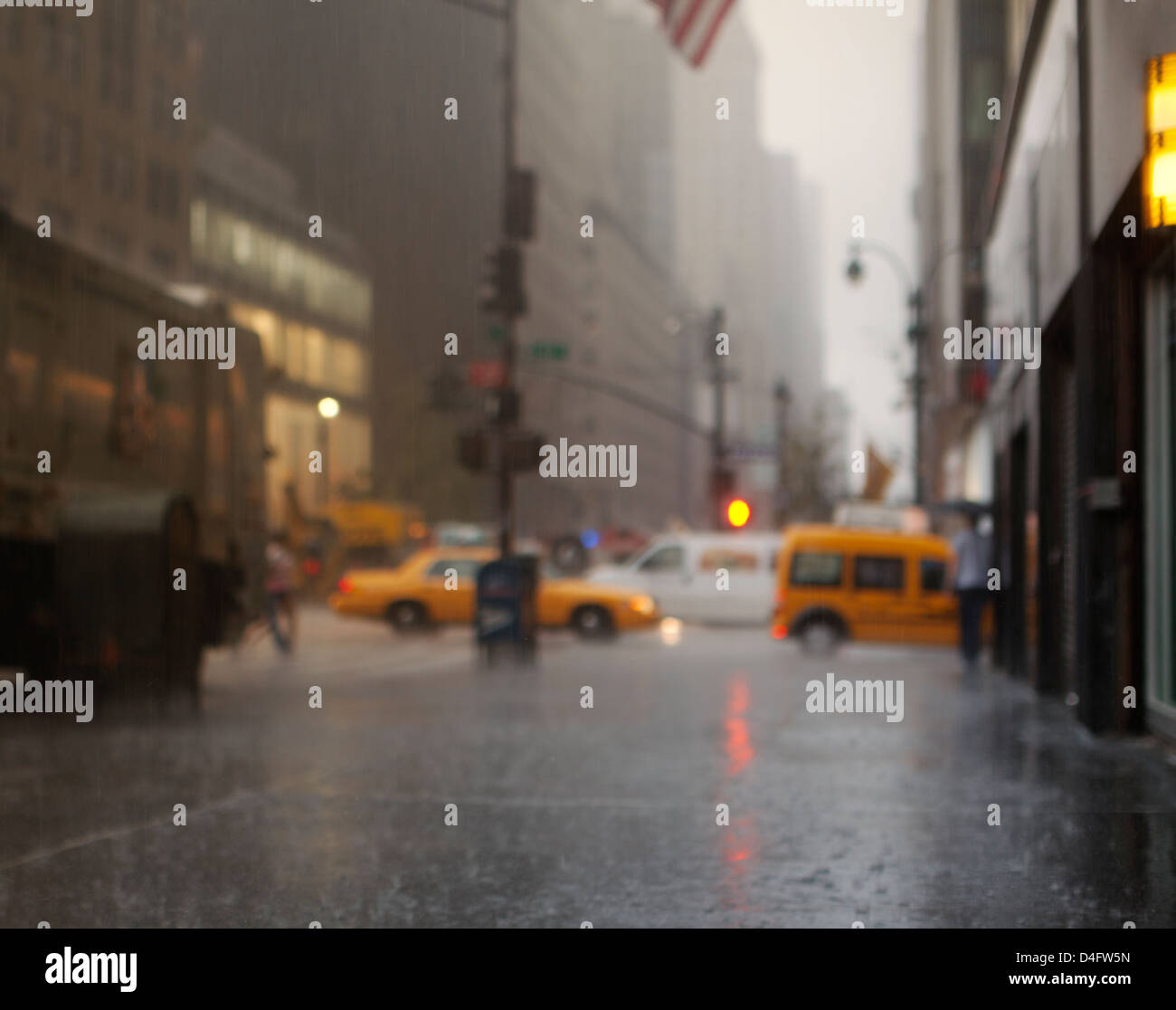 Blurred view of rainy city street - Stock Image