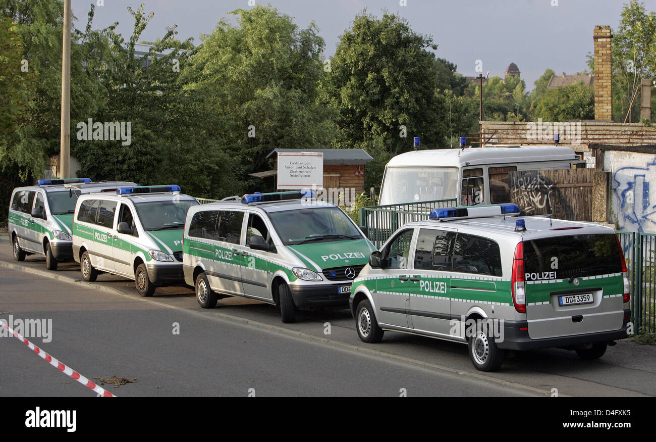 Police cars captured in front of an unused company site in Leipzig ...