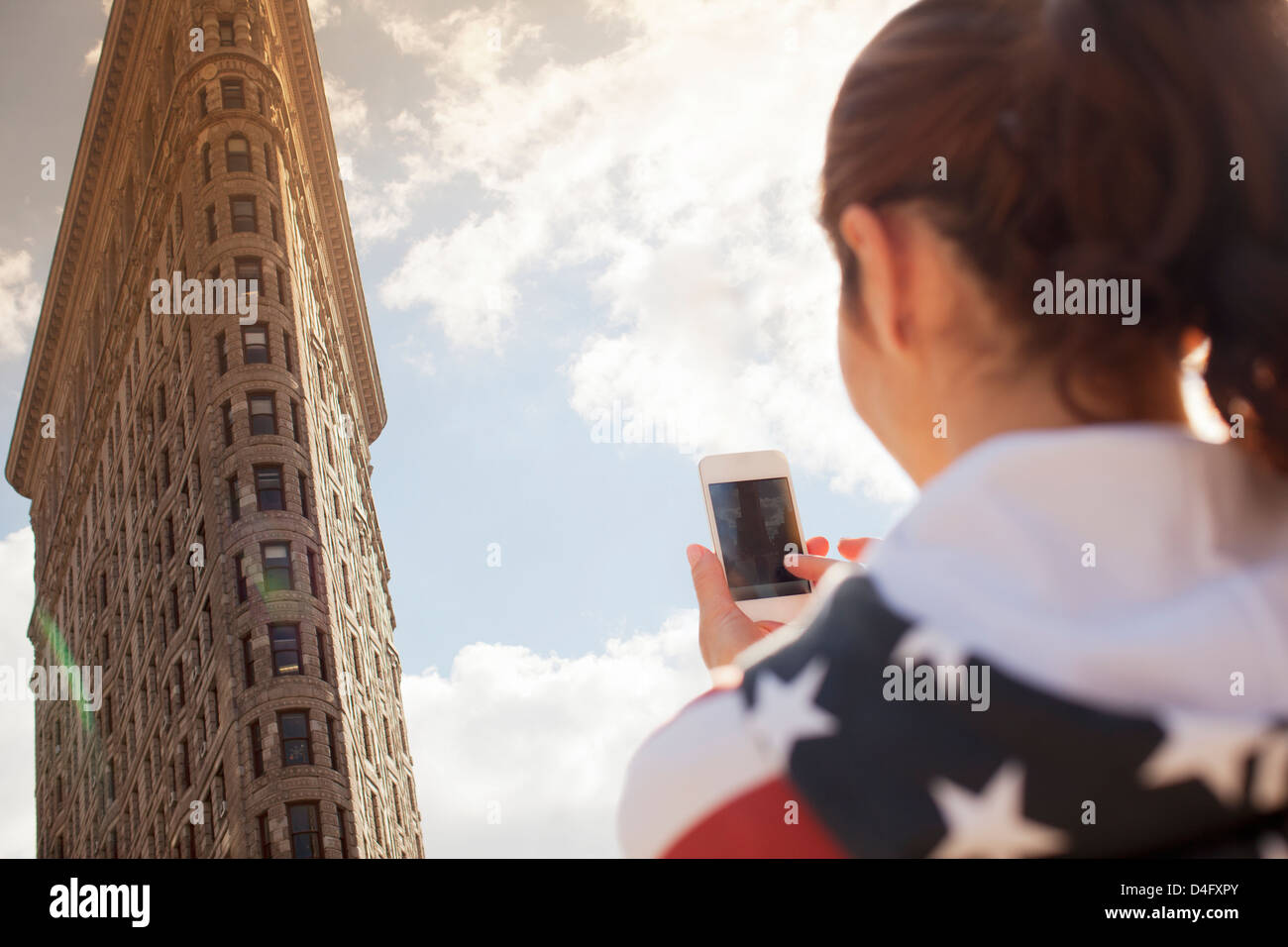 Woman taking picture of highrise - Stock Image
