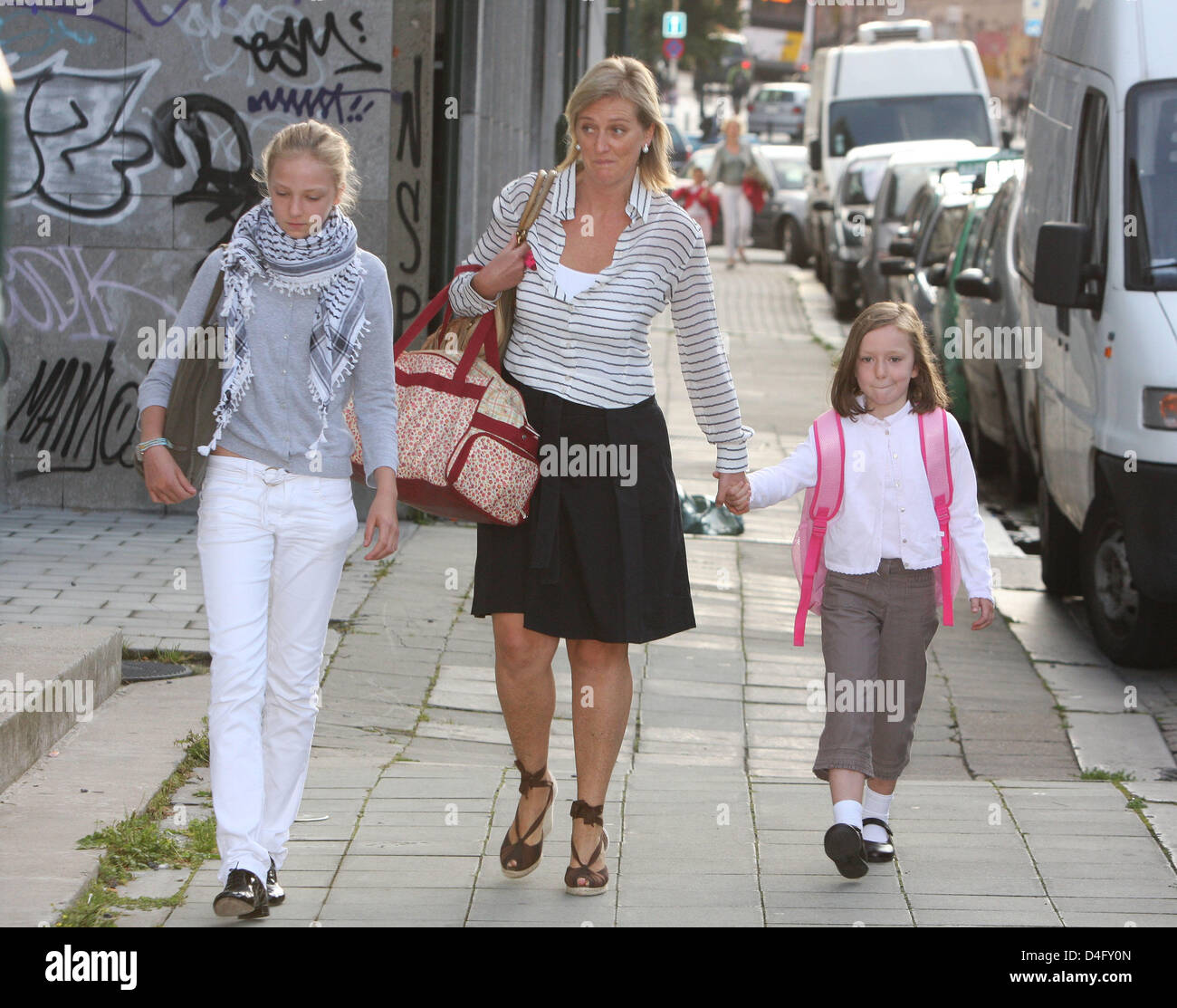 Belgium's Princess Astrid (C) escorts her daughters Princess Maria Laura  (L) and