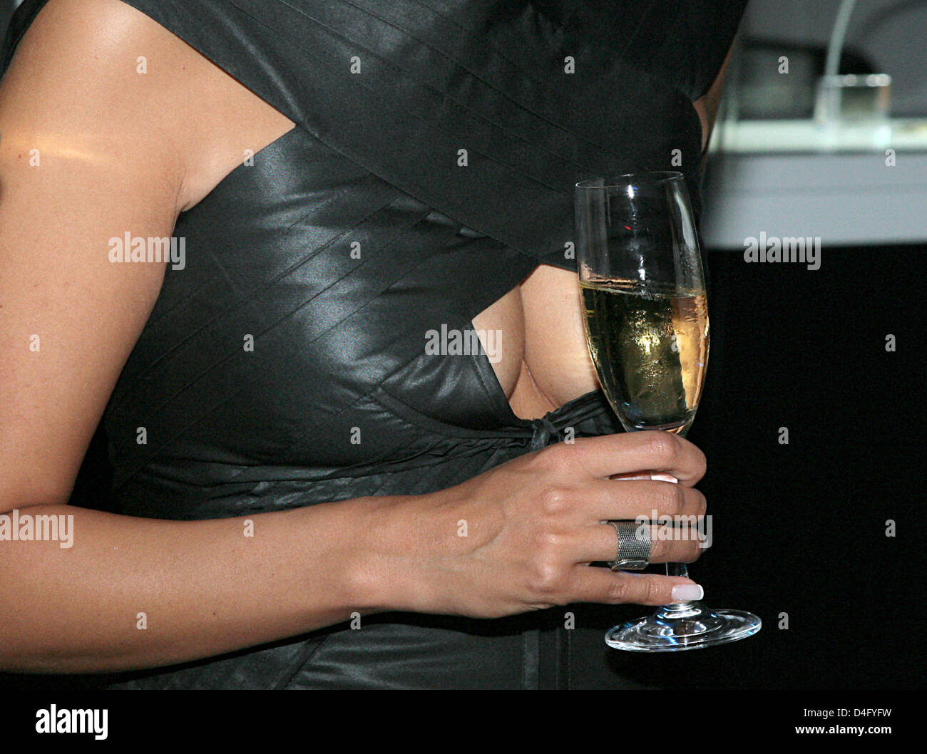Producer Minu Barati, wife of former German Foreign Minister Joschka Fischer, holds a glass of champagne in front - Stock Image