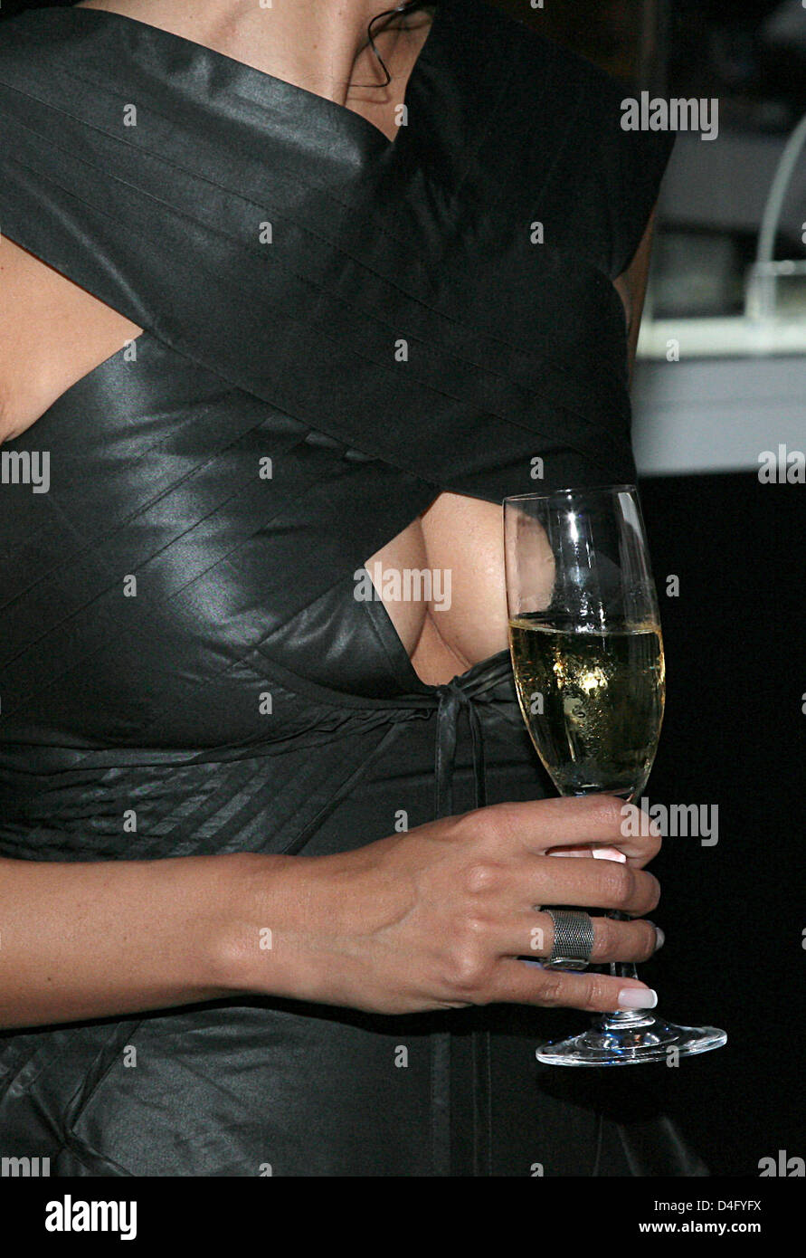 Producer Minu Barati, wife of former German Foreign Minister Joschka Fischer, holds a glass of champagne in front Stock Photo