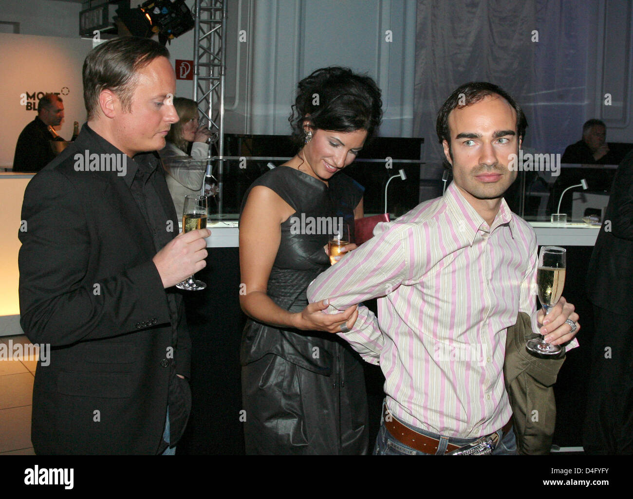Producer Minu Barati (C), wife of former German Foreign Minister Joschka Fischer, and fashion designers Claus Unrath - Stock Image