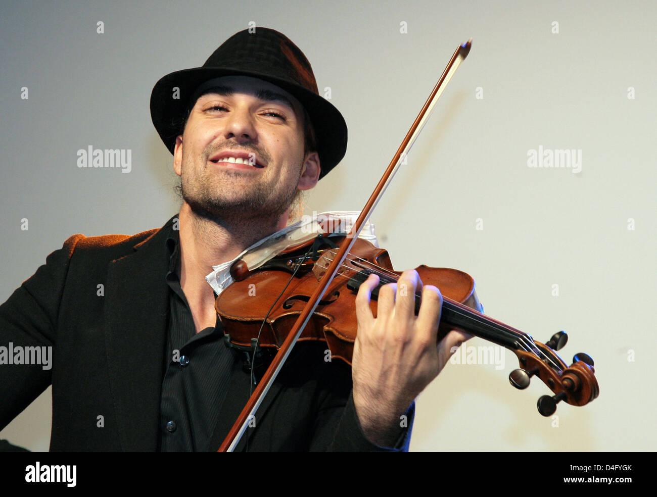 German star violinist David Garrett performs during a Montblanc watch presentation at KaDeWe in Berlin, Germany, Stock Photo