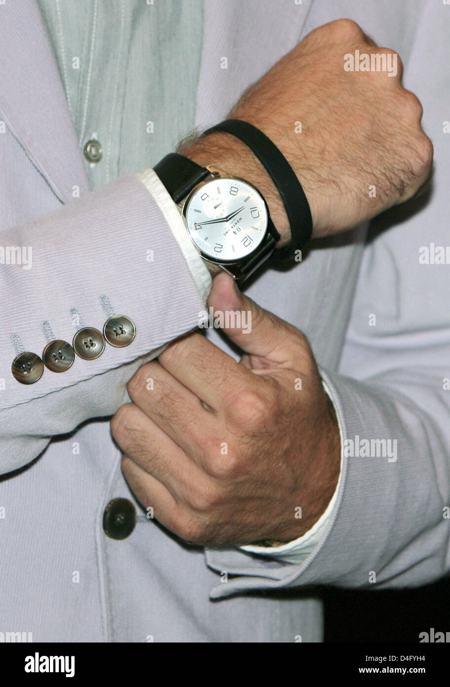 Former Bosnian soccer player Sergej Barbarez presents his wrist watch during a Montblanc watch presentation at KaDeWe - Stock Image