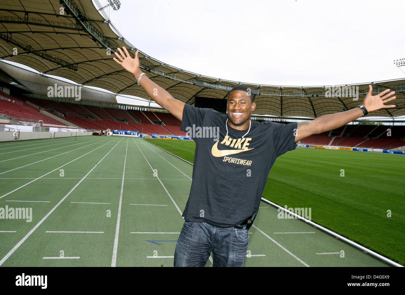 US hurdler David Oliver, who won the bronze medal at the 2008 Olympic Games in Beijing, China, poses for photographers - Stock Image