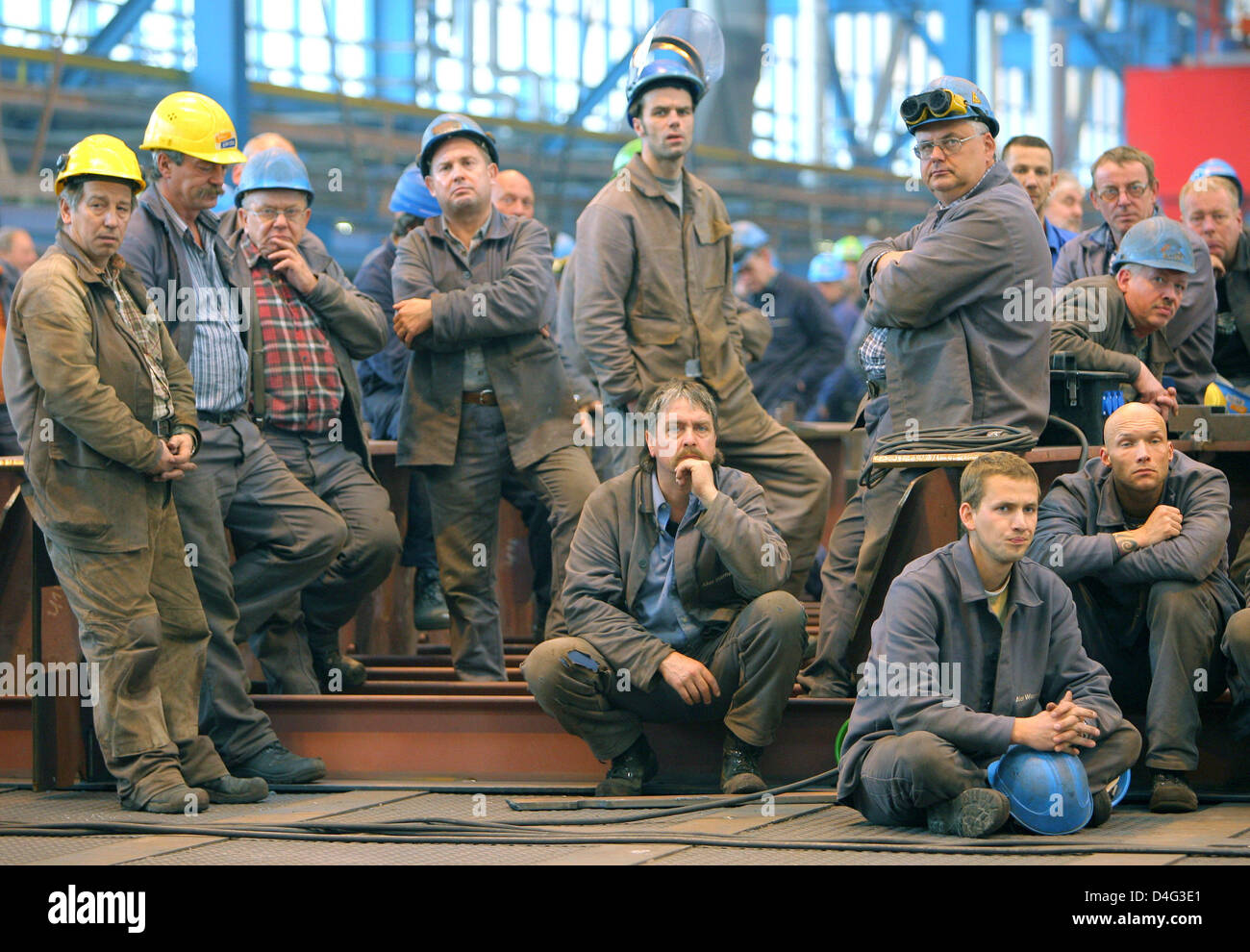 Shipyard workers listen to the new management of the reformed shipbuilding group 'Wadan Yards', formerly - Stock Image