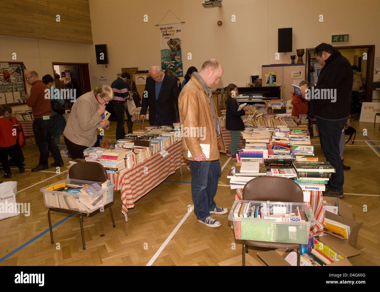 People perusing books at a charity Book Day in aid of a heart charity - Stock Image