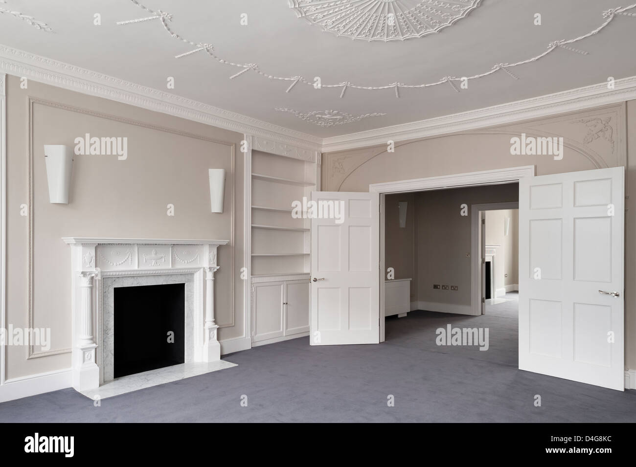 empty communicating rooms with open doors and fireplace - Stock Image