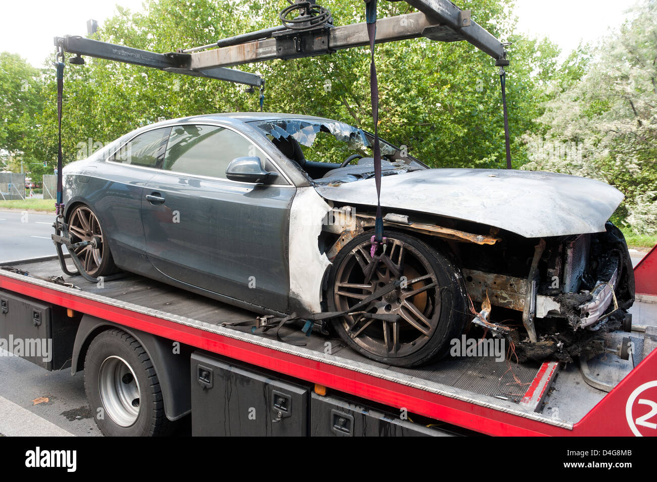 Berlin, Germany, a burnt Audi A5 on a tow - Stock Image