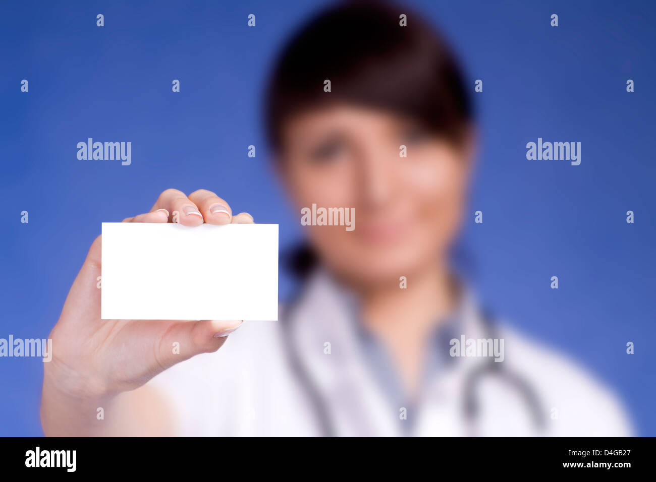 Women Doctor holding blank business card. Focus on fingers and card ...