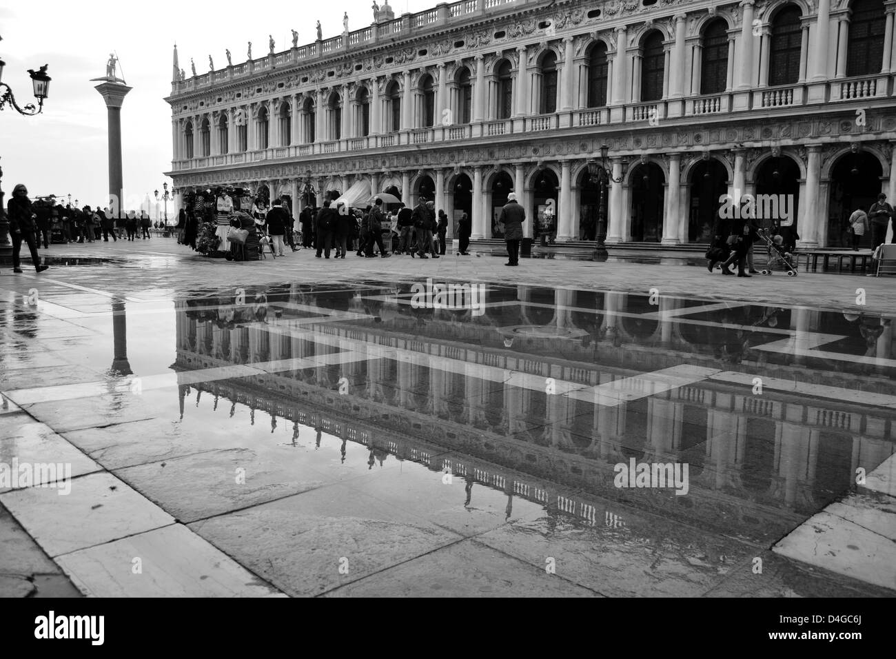 Reflections in the puddles at st marks square Venice - Stock Image