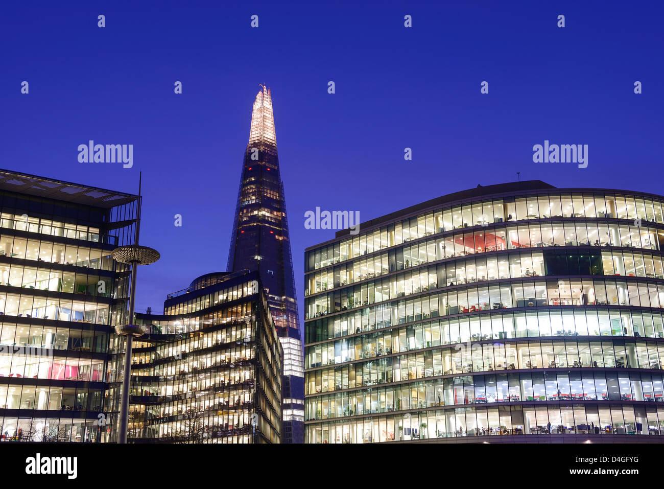The Shard and offices at night London UK - Stock Image
