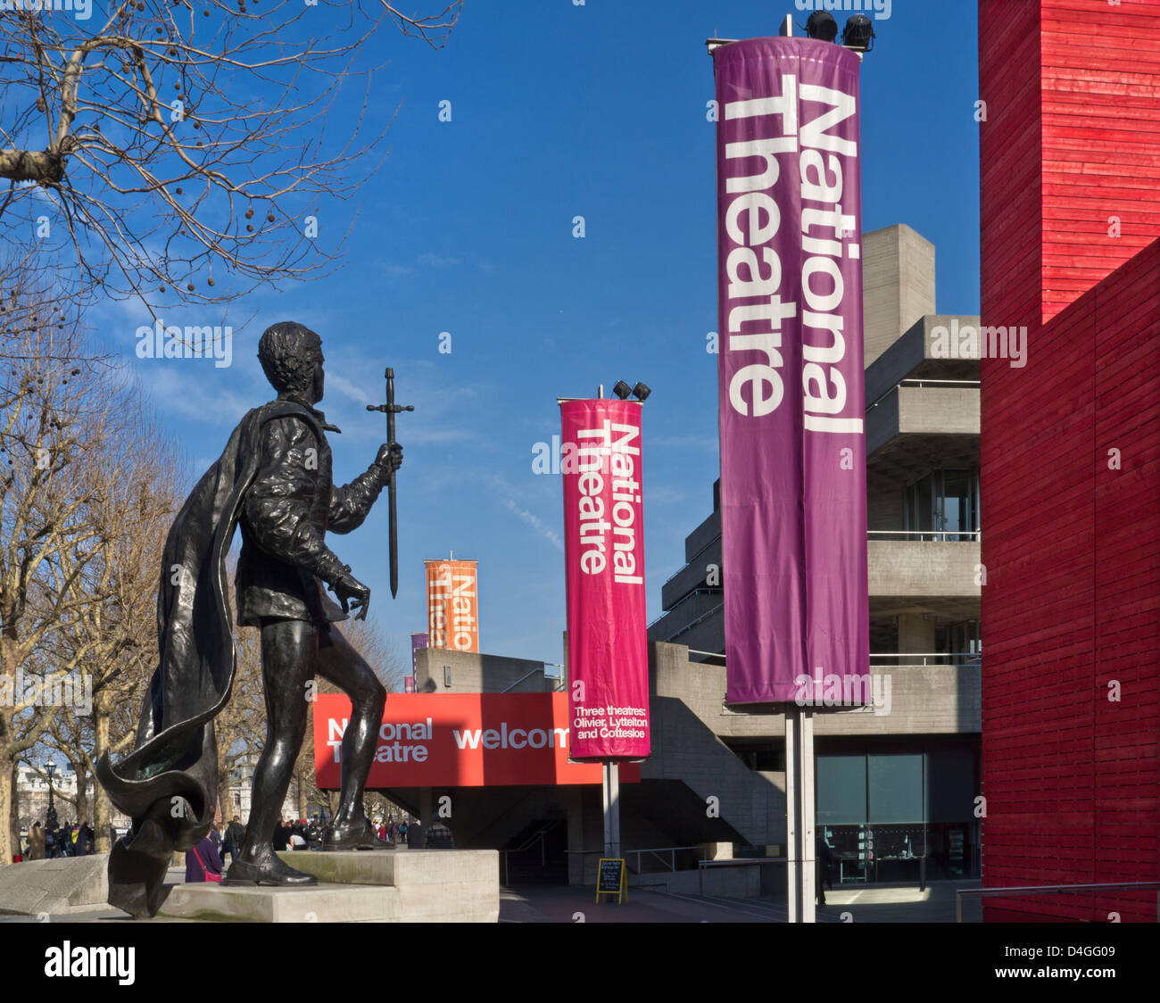 National Theatre and bronze statue of Lord Laurence Olivier in spring South Bank River Thames London UK - Stock Image