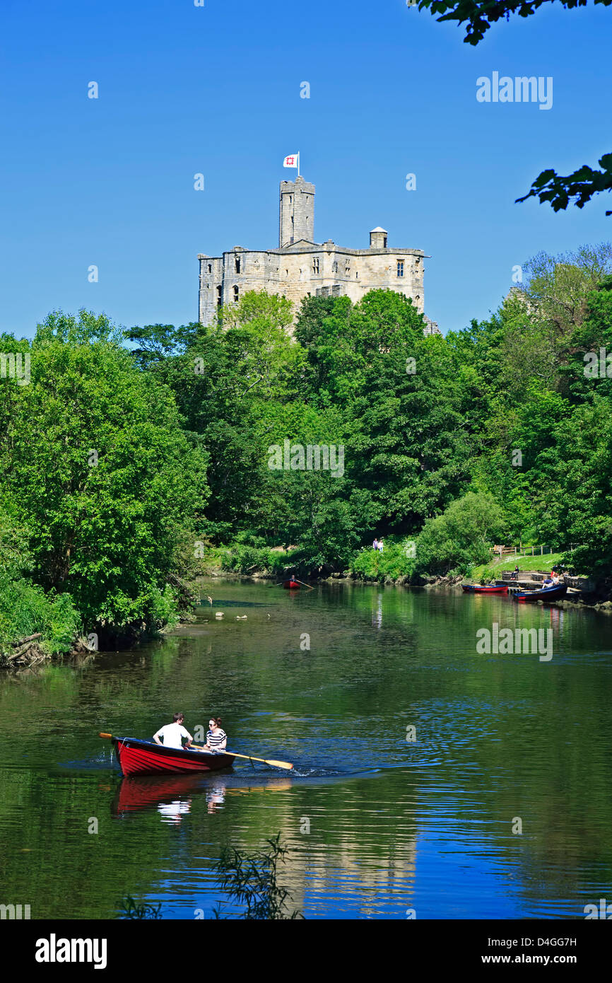 Boaters on River Coquet and Warkworth Castle, Warkworth, England, United Kingdom - Stock Image