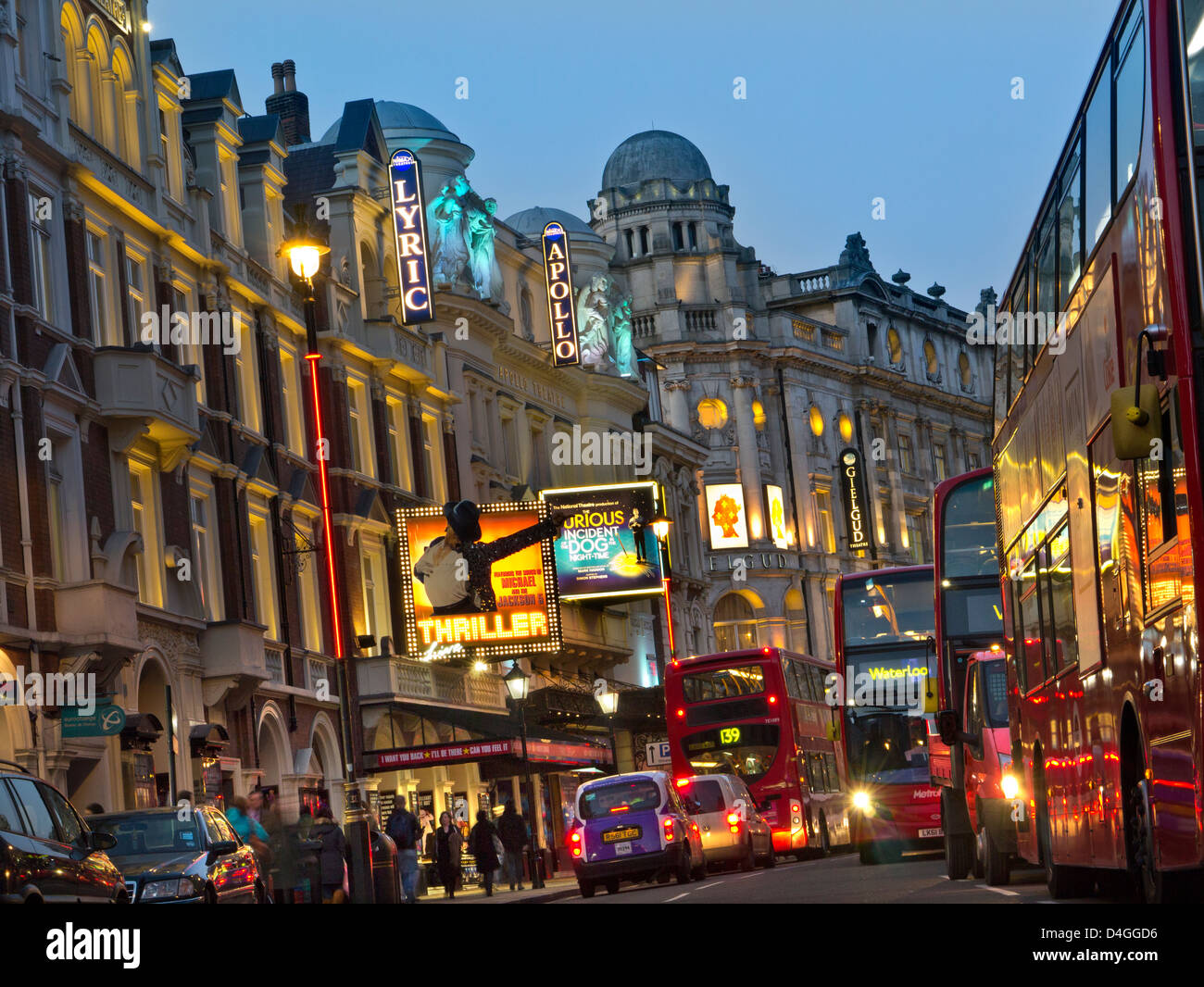 Theatreland with red buses in Shaftesbury Avenue West End London UK - Stock Image