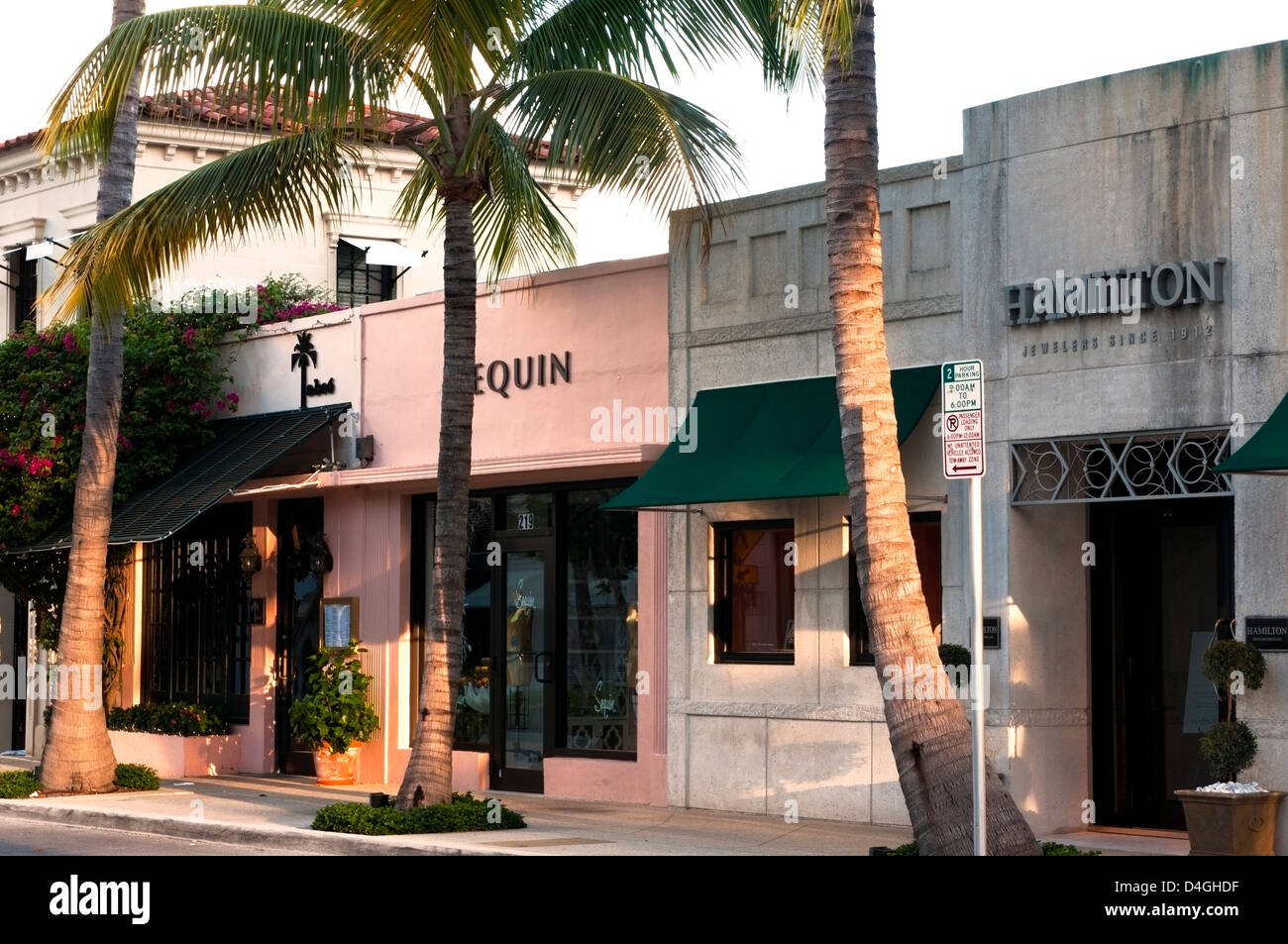 The palm tree lined street and storefronts of Worth Avenue, West Pam Beach Florida Stock Photo