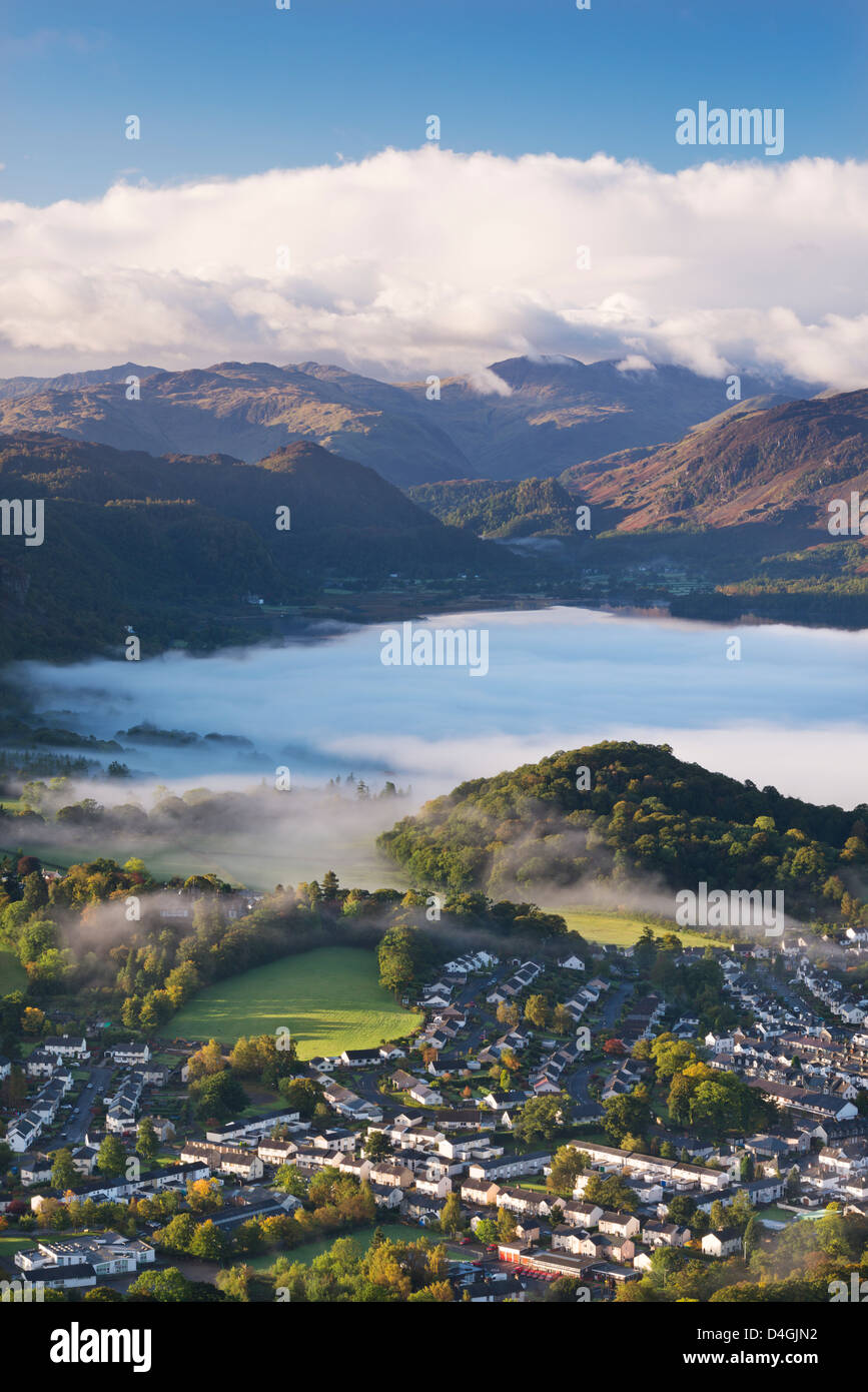 Aerial view over Keswick to a mist covered Derwent Water, Lake District, Cumbria, England. Autumn (October) 2012. - Stock Image