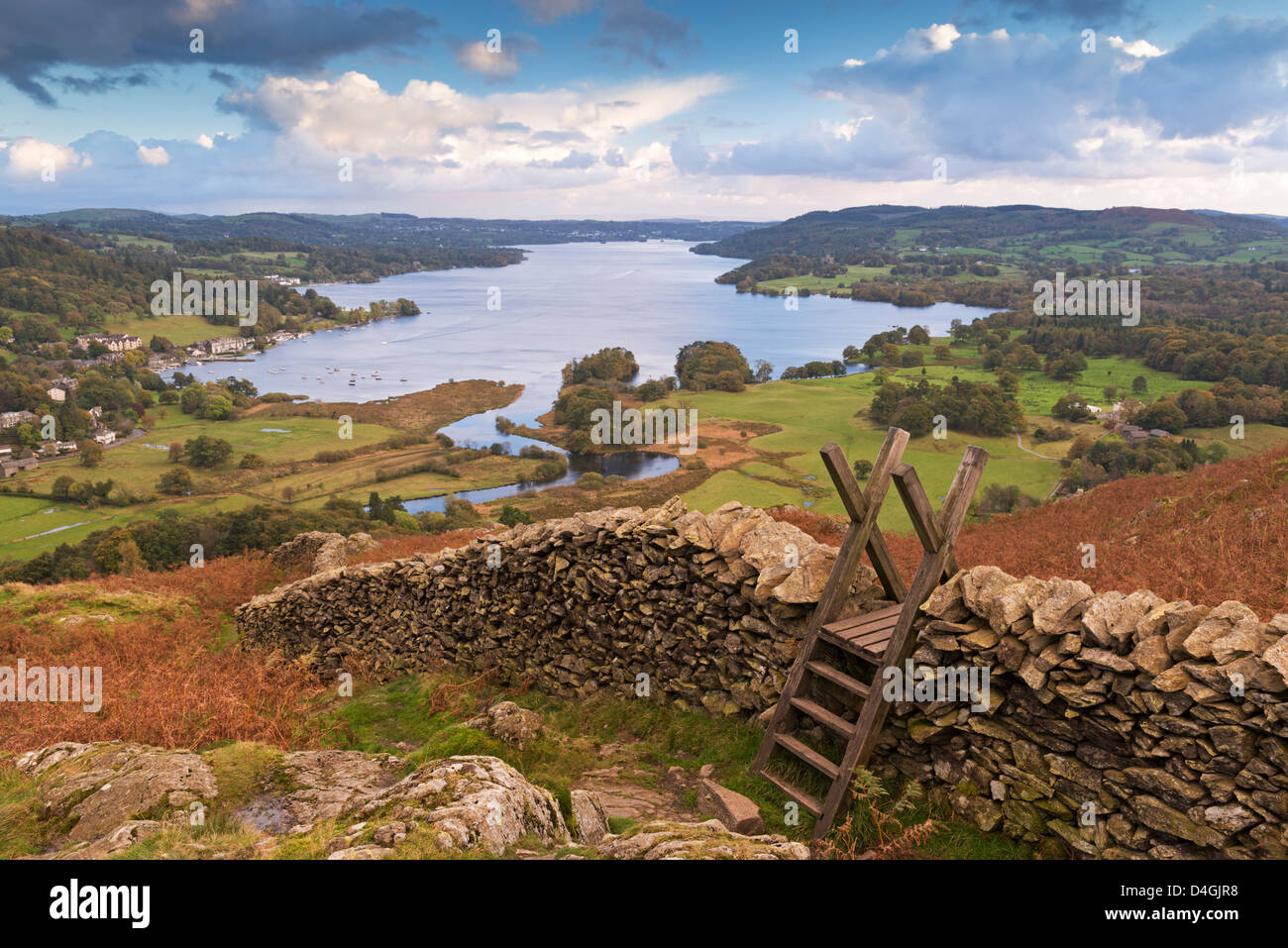Drystone Wall and stile with views to Windermere, Lake District, Cumbria, England. Autumn (October) 2012. - Stock Image