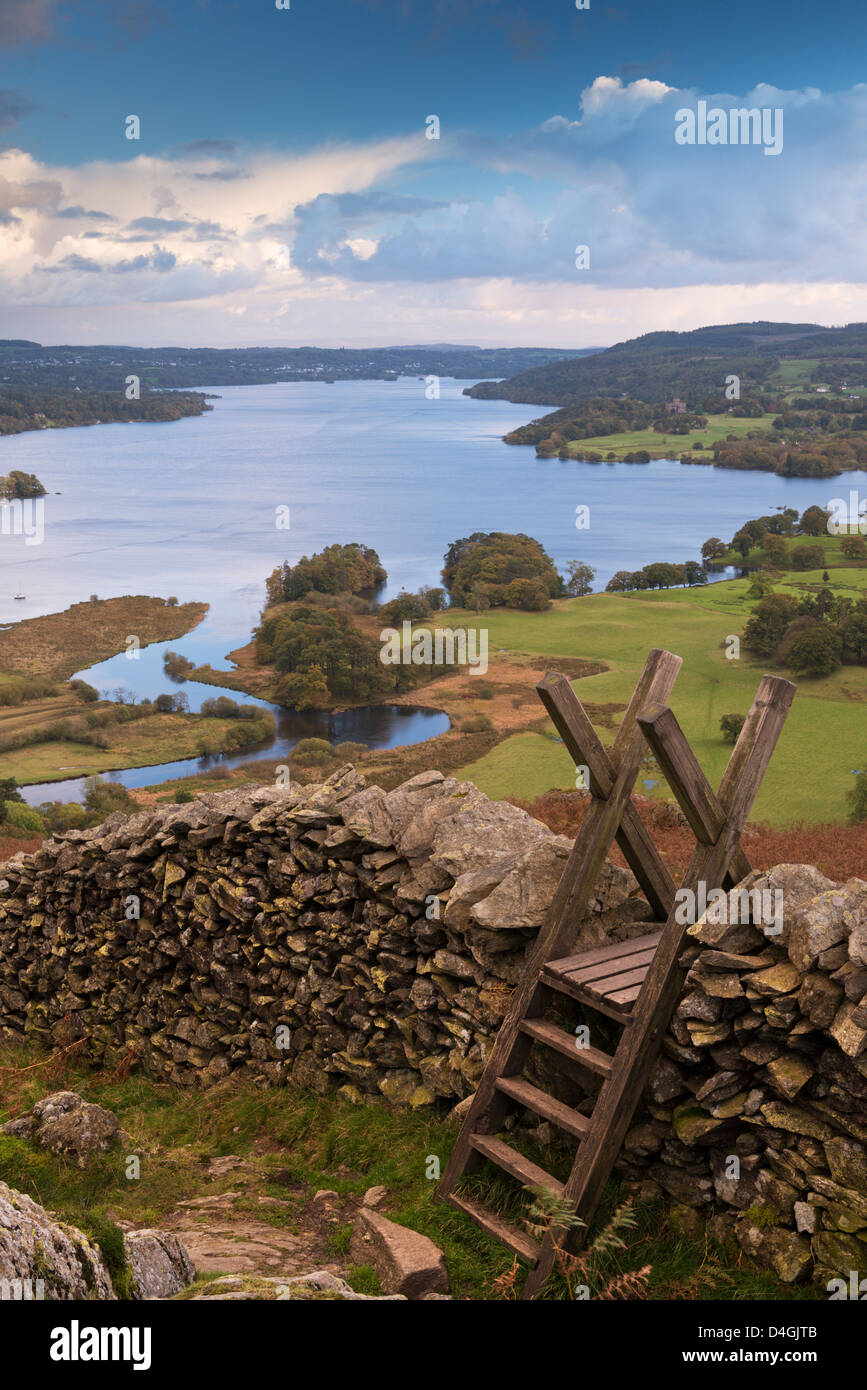 Drystone wall and stile above Windermere in the Lake District, Cumbria, England. Autumn (October) 2012. - Stock Image