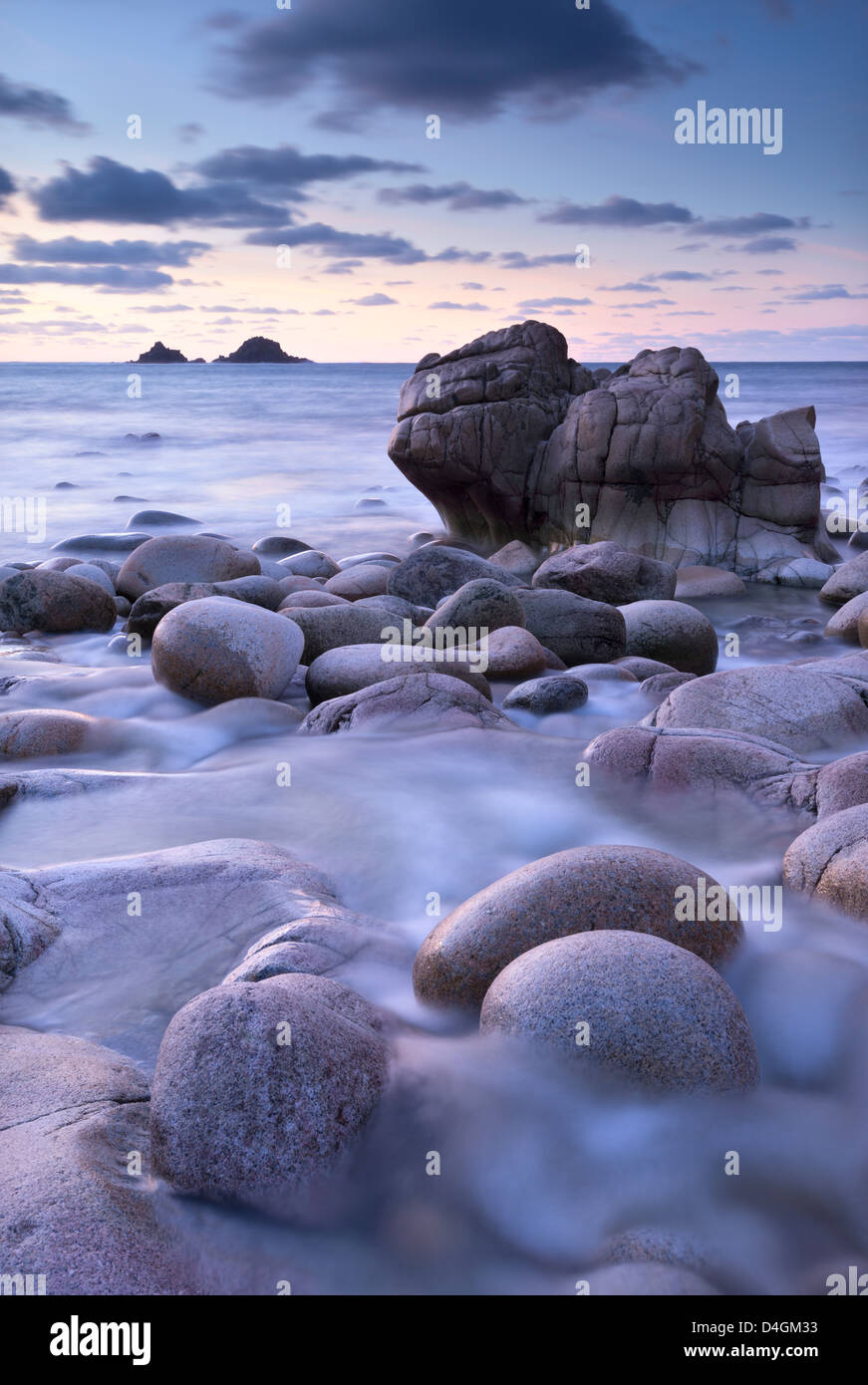 Twilight over Porth Nanven cove near Land's End, Cornwall, England. Winter (December) 2012. - Stock Image
