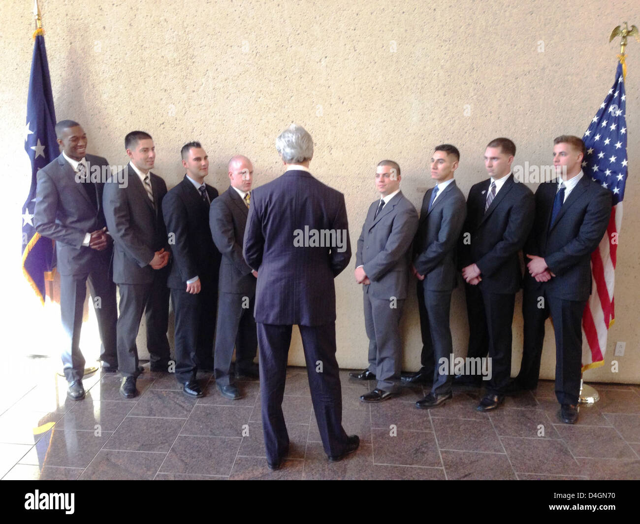 Secretary Kerry Speaks With Marine Security Guards - Stock Image