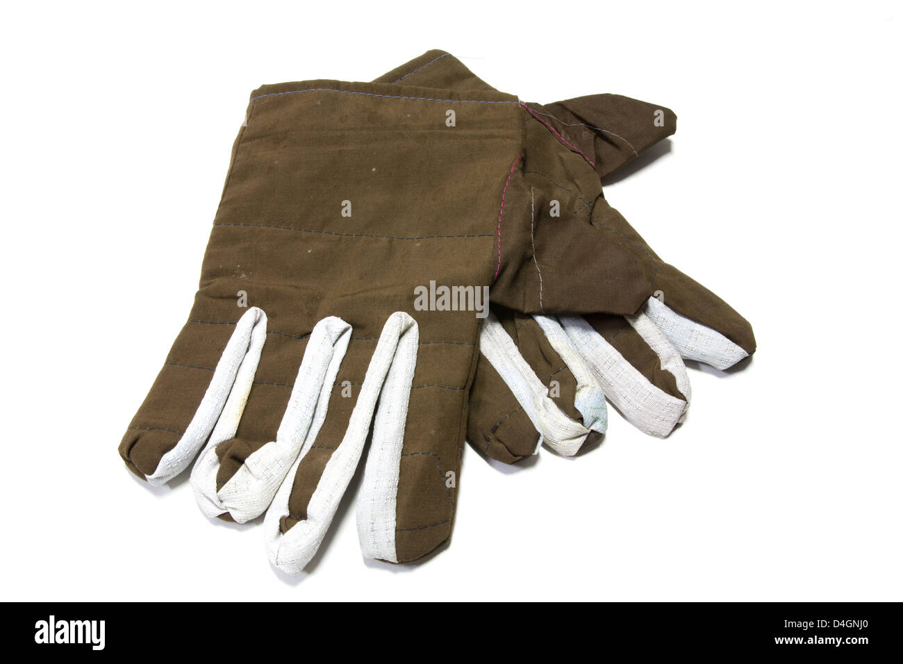 A pair of warm gloves in brown fabric for the winter on a white background into. - Stock Image